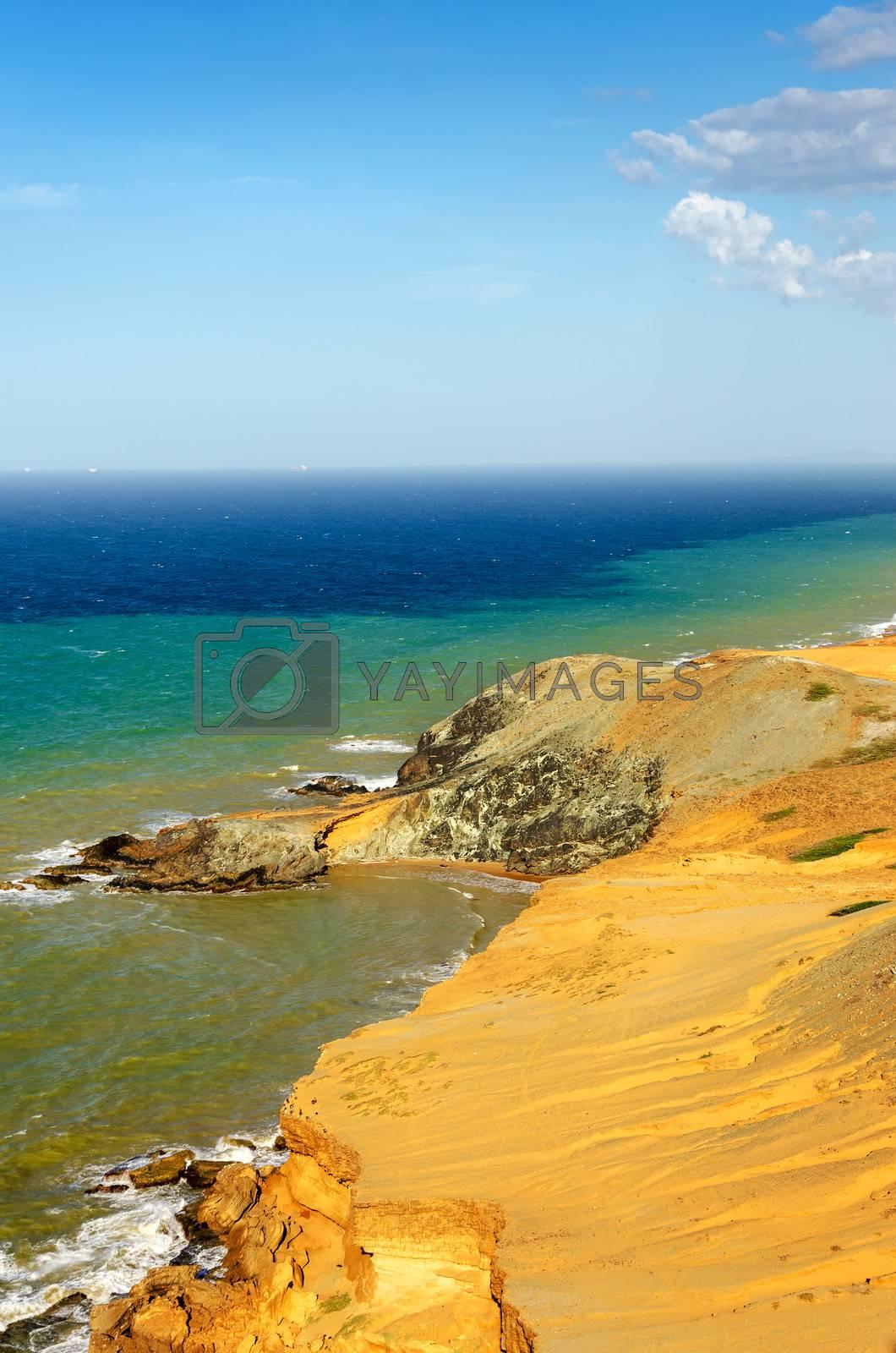 View of a dry desert coastline and the Caribbean Sea with various shades of blue near Cabo de la Vela in La Guajira, Colombia