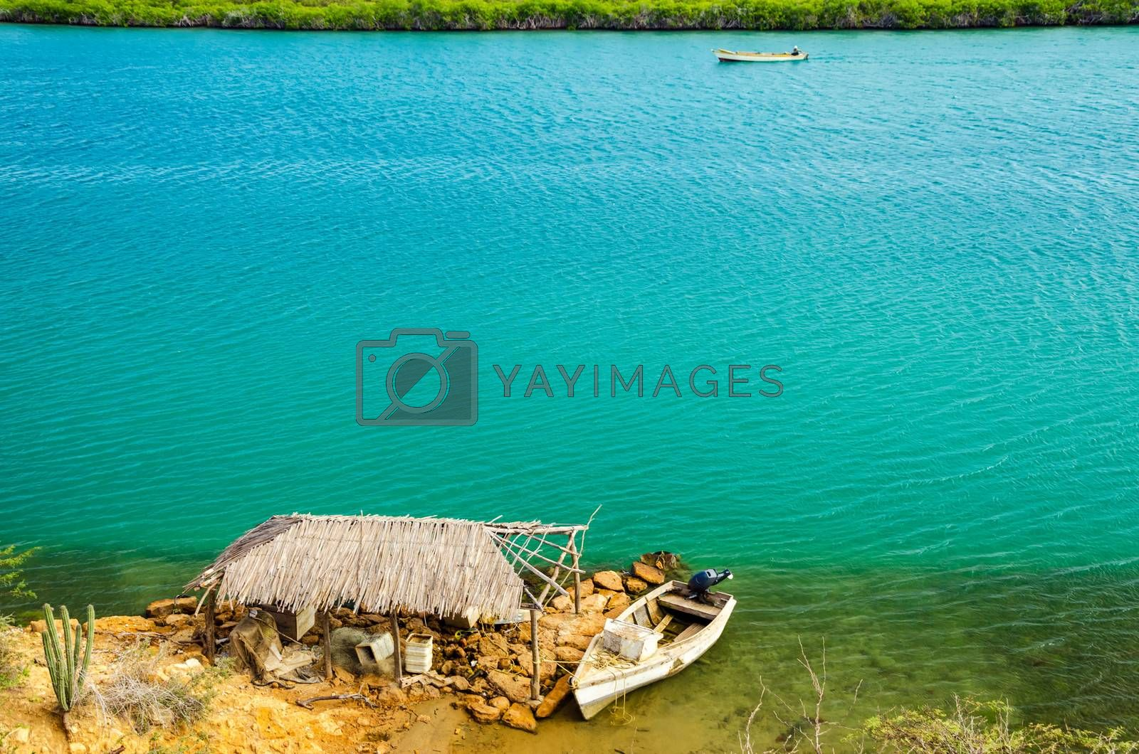 Inlet to a bay passing by a dilapidated shack near Punta Gallinas in La Guajira, Colombia
