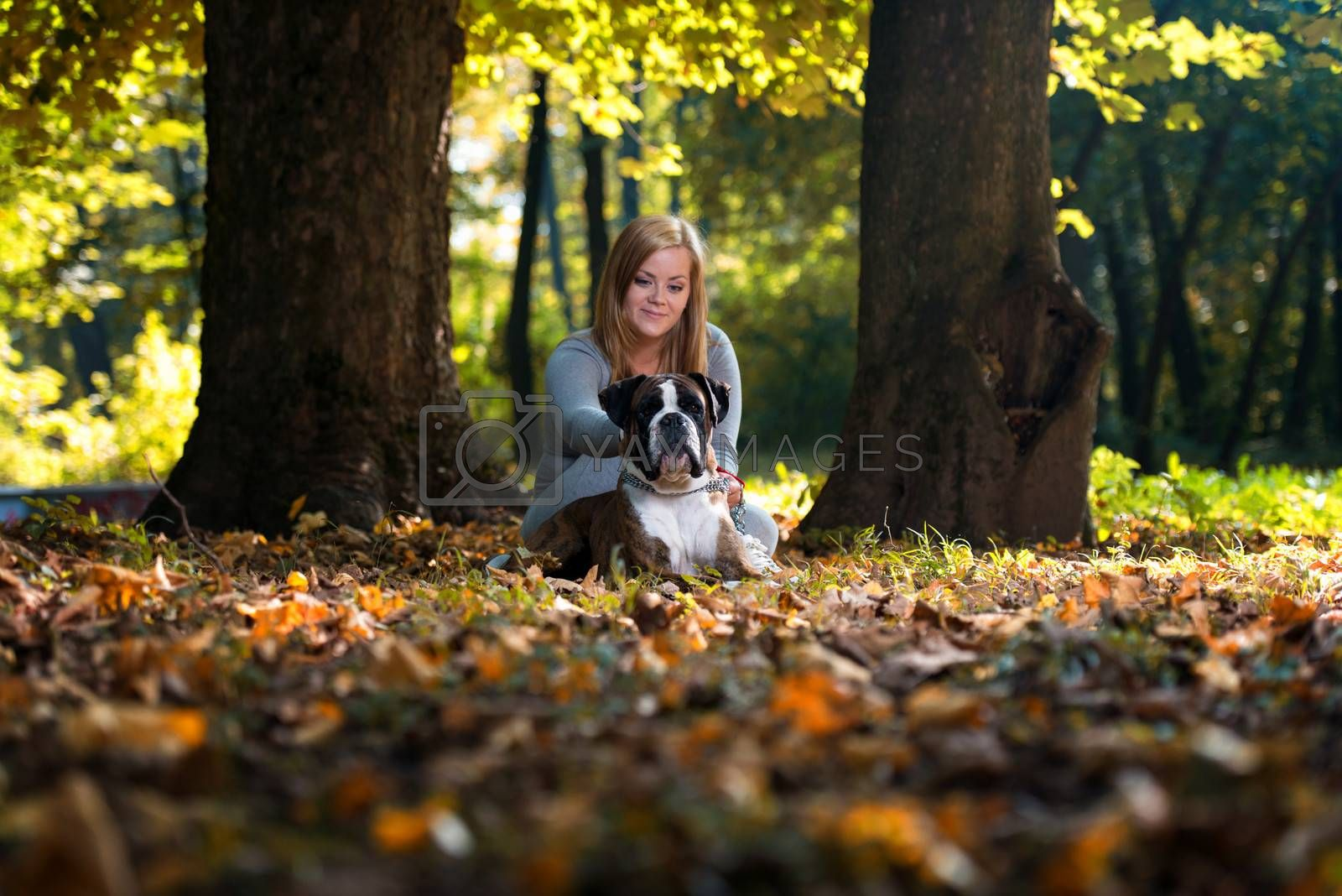 Happy Pretty Woman With German Boxer