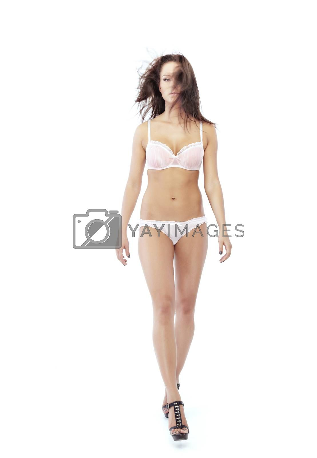 Stylish model in lingerie going on a white background