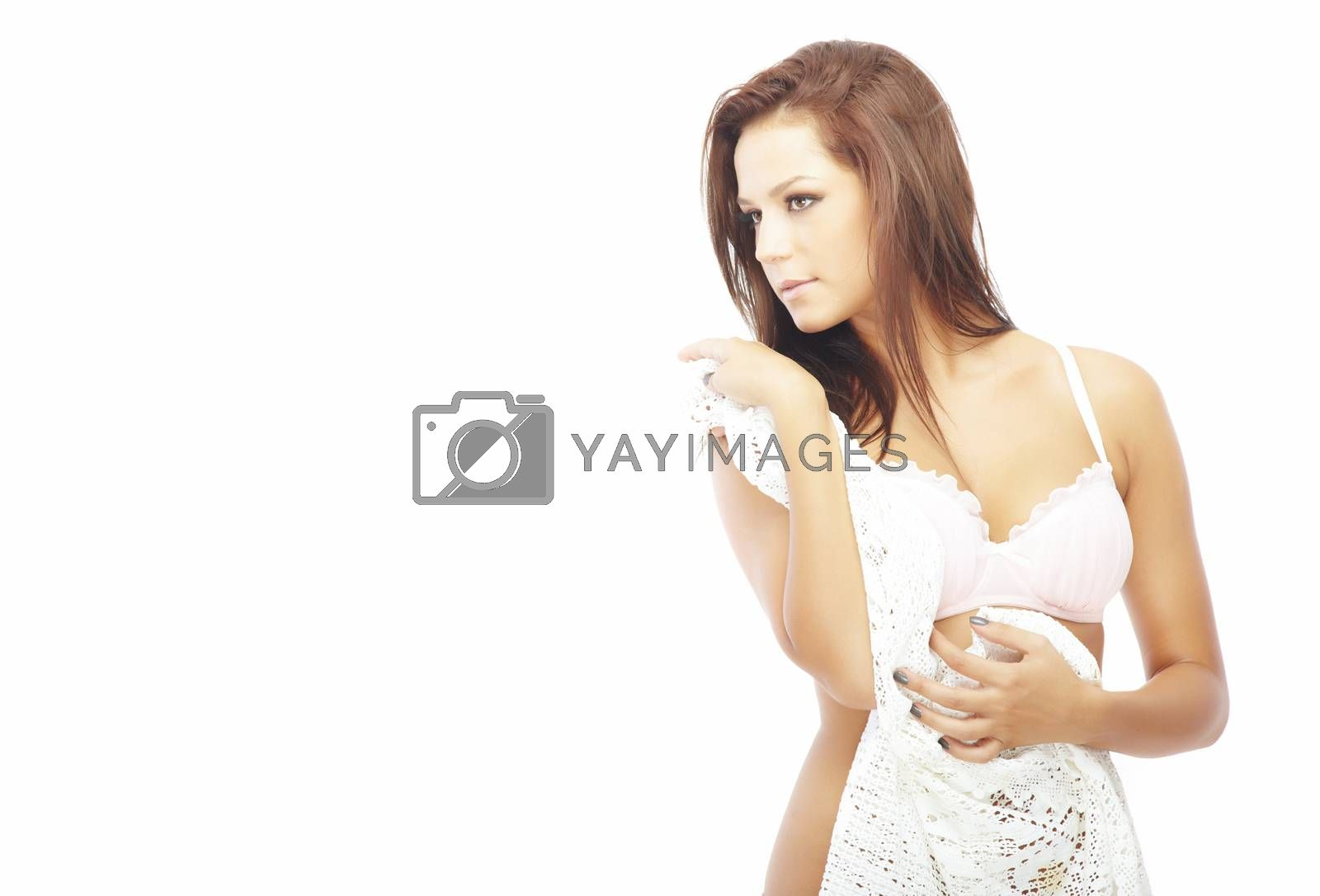 Beautiful young lady in camisole on a white background