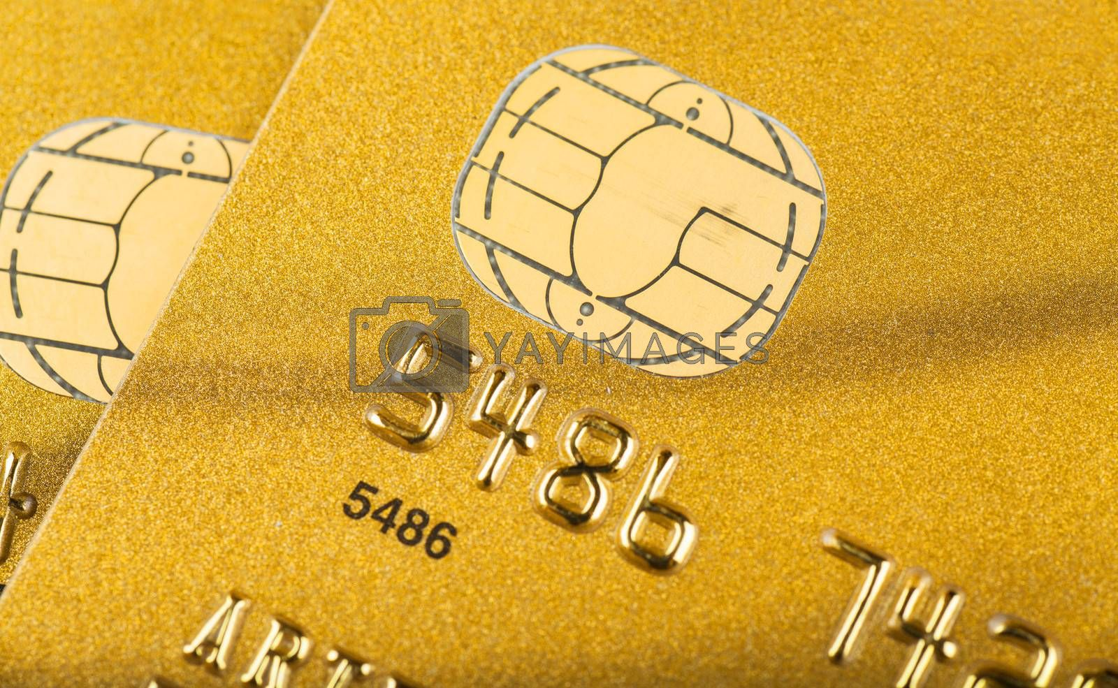 Macro view of golden credit cards with microchips