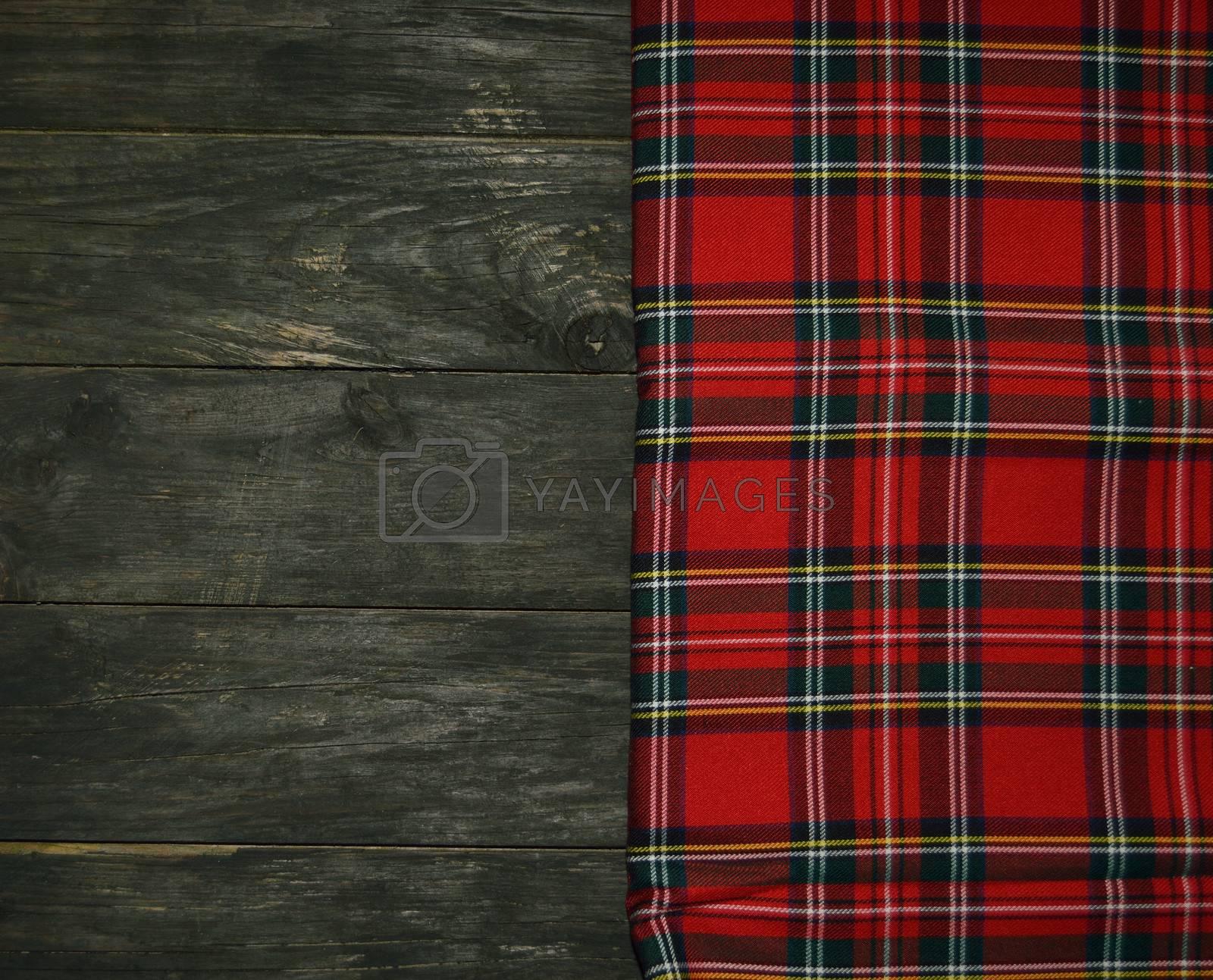 tartan textile on wooden background