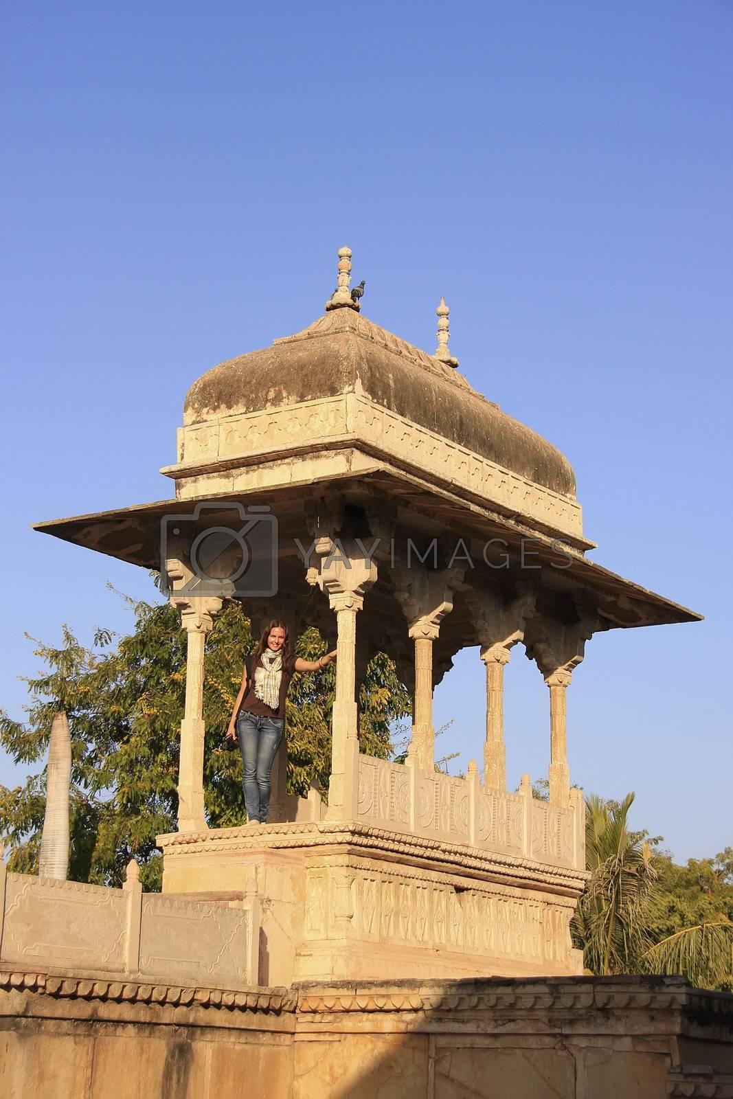 Young woman standing at Raniji ki Baori, Bundi, Rajasthan, India