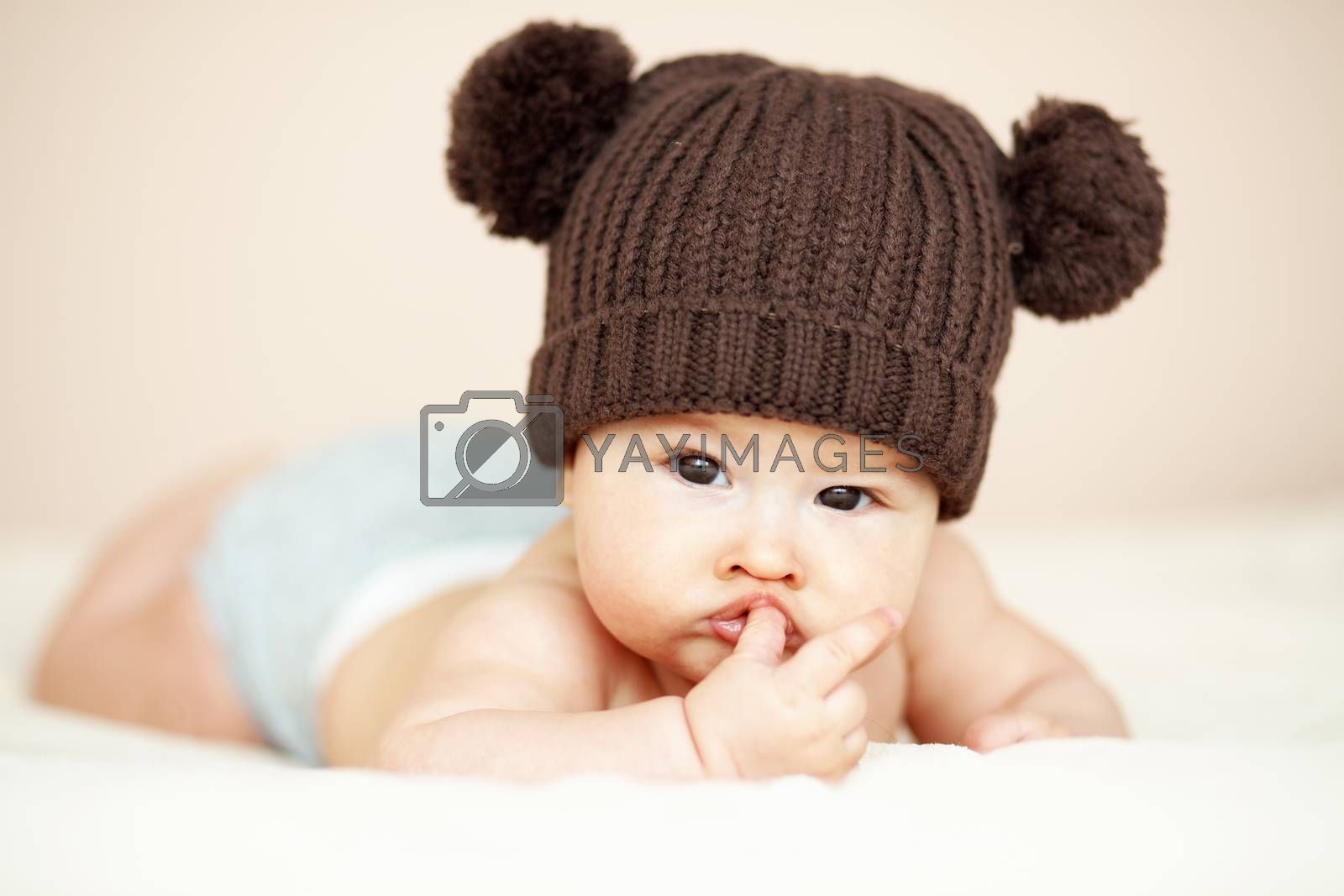 Portrait of a cute 3 monthes baby lying down on a blanket