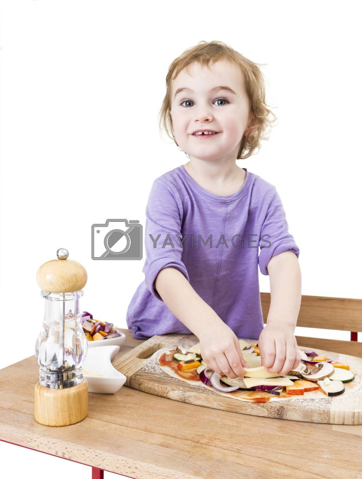 cute girl making pizza with a smile. isolated on white background