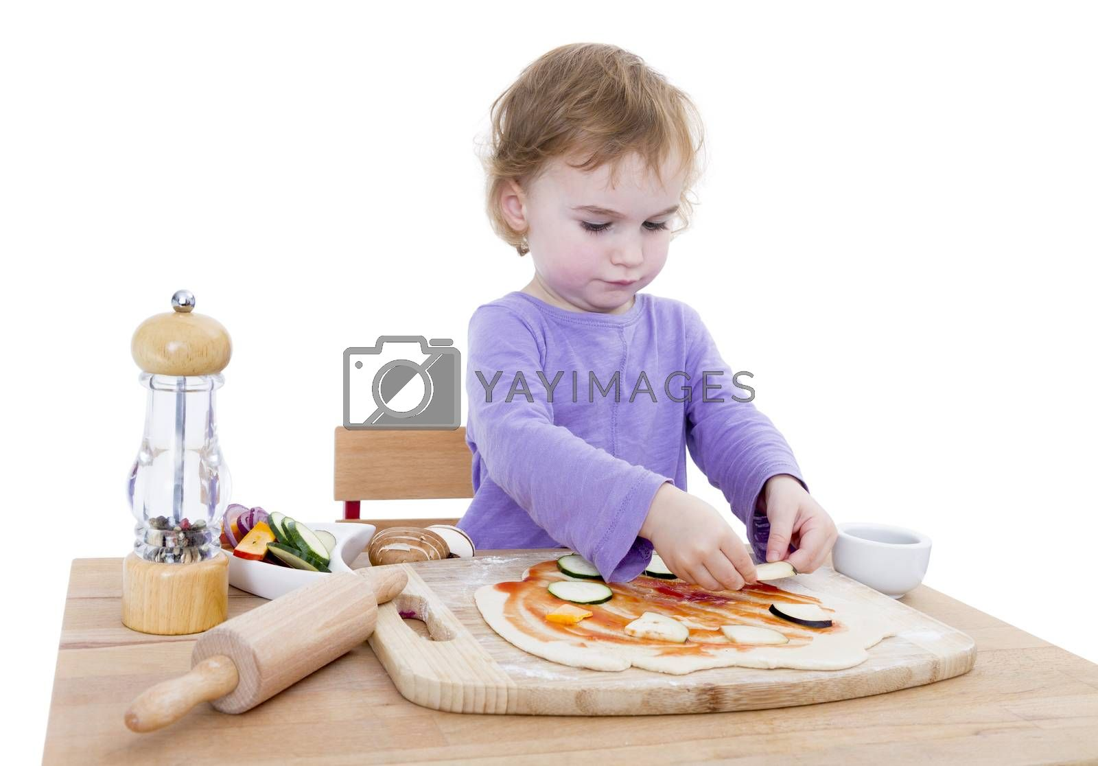 cute girl making pizza isolated in white background