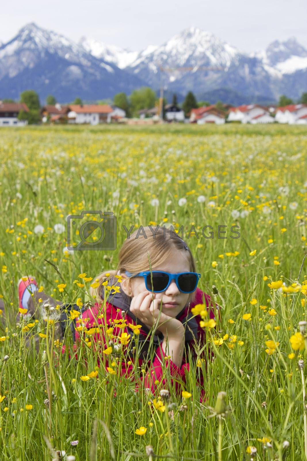 portrait of a girl against the panorama of the Alps by miradrozdowski