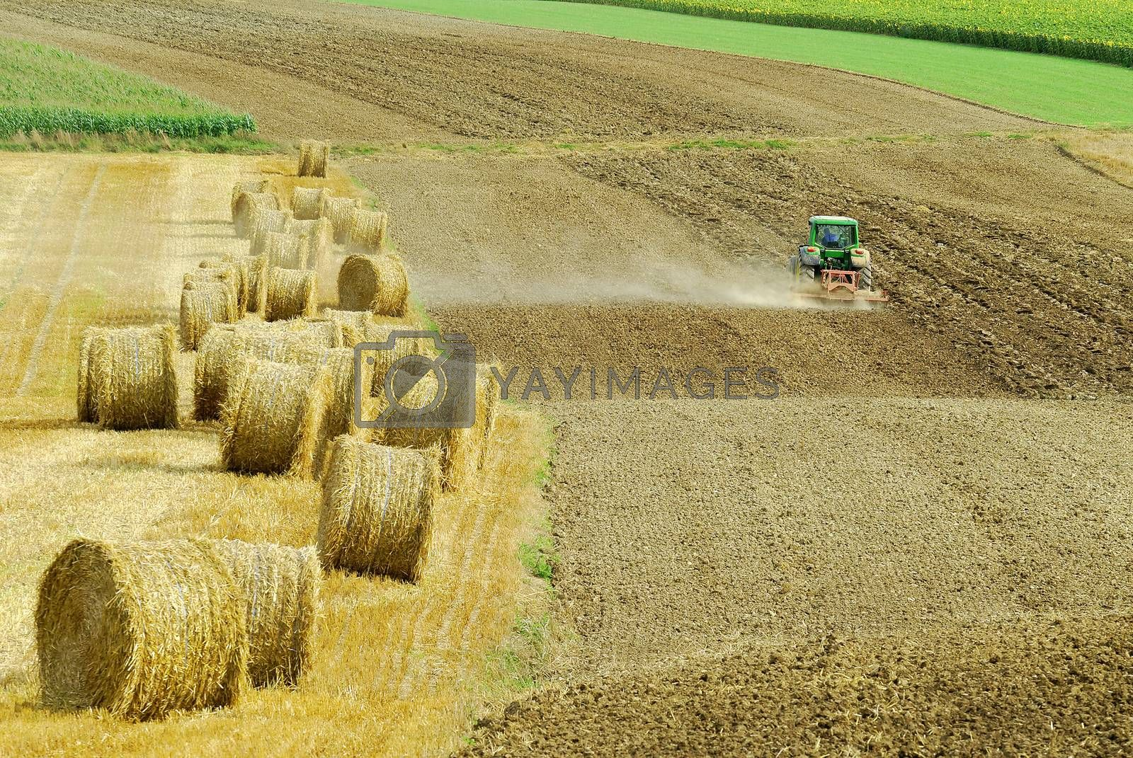 a tractor plowing the fields