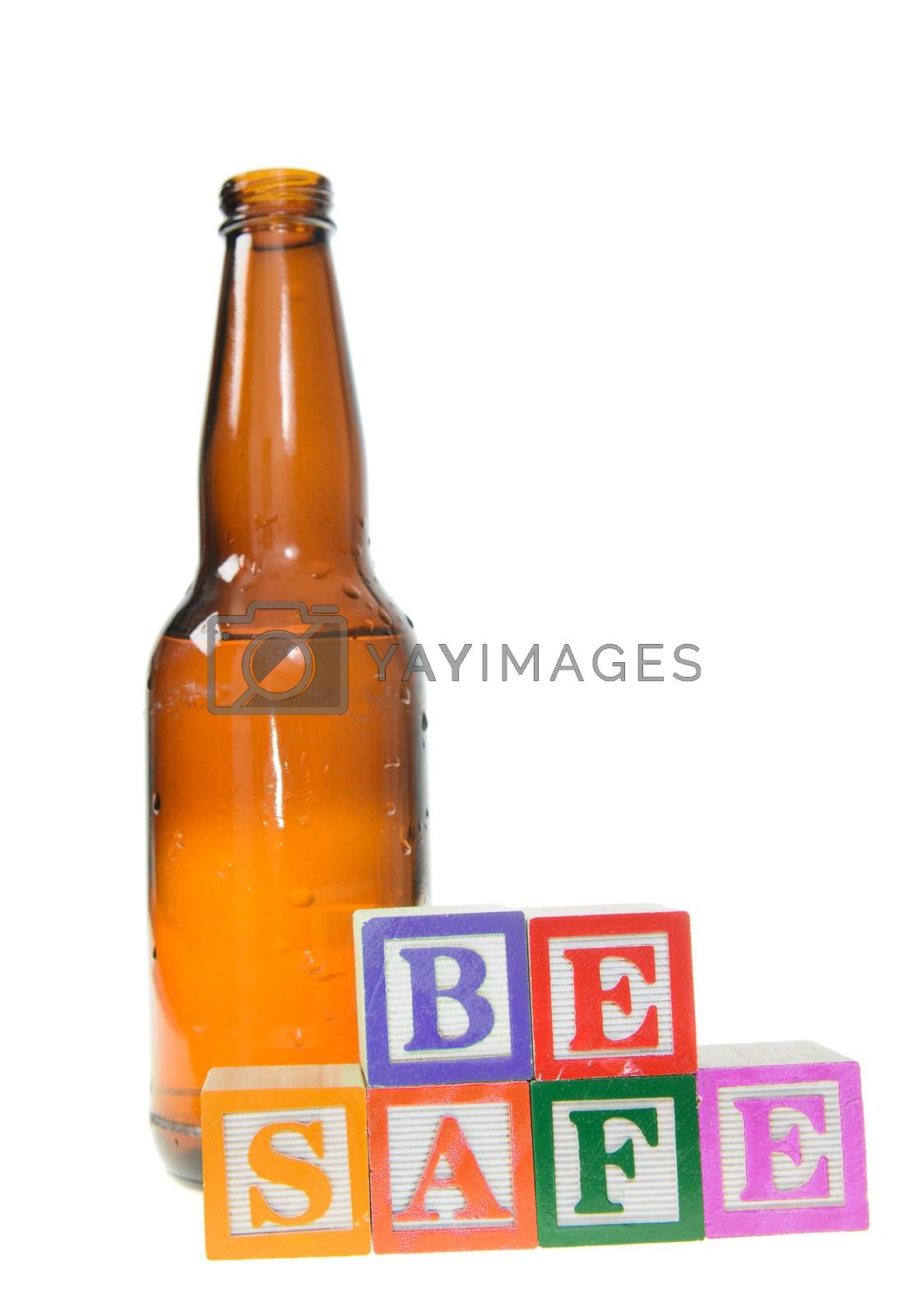 Letter blocks spelling be safe with a beer bottle. Isolated on a white background