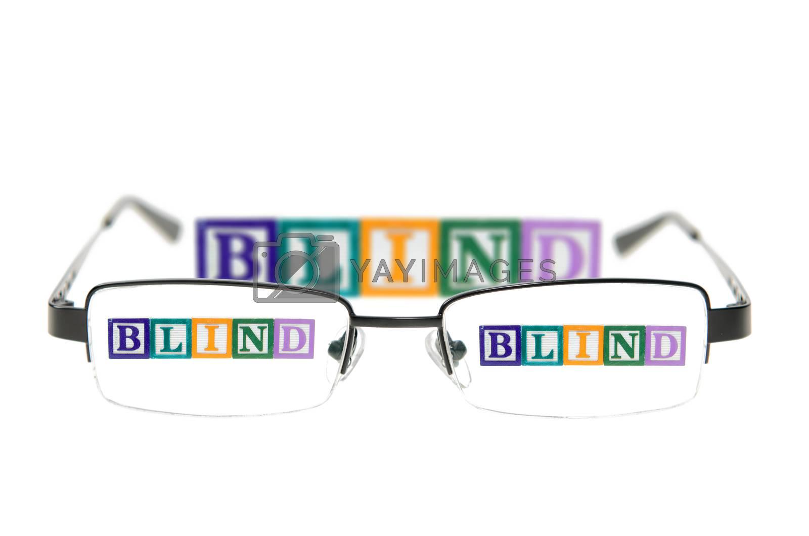 Letter blocks spelling blind through glasses. Isolated on white