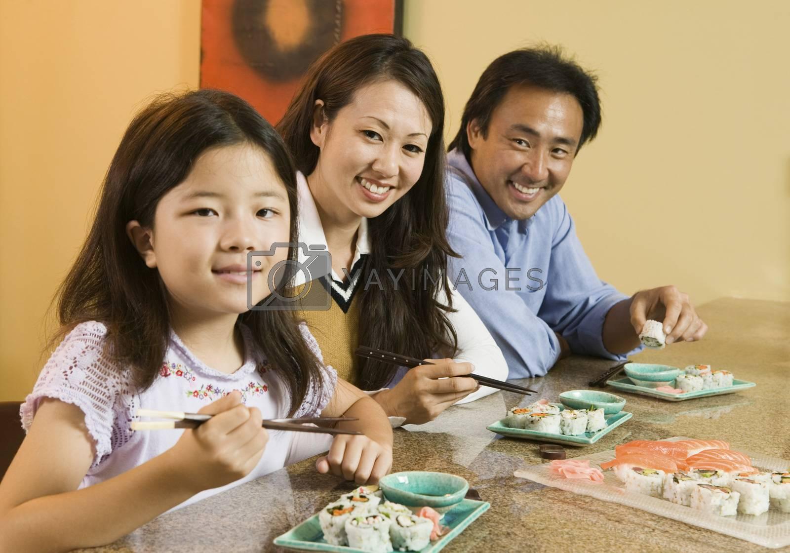 Family Eating Sushi Together portrait