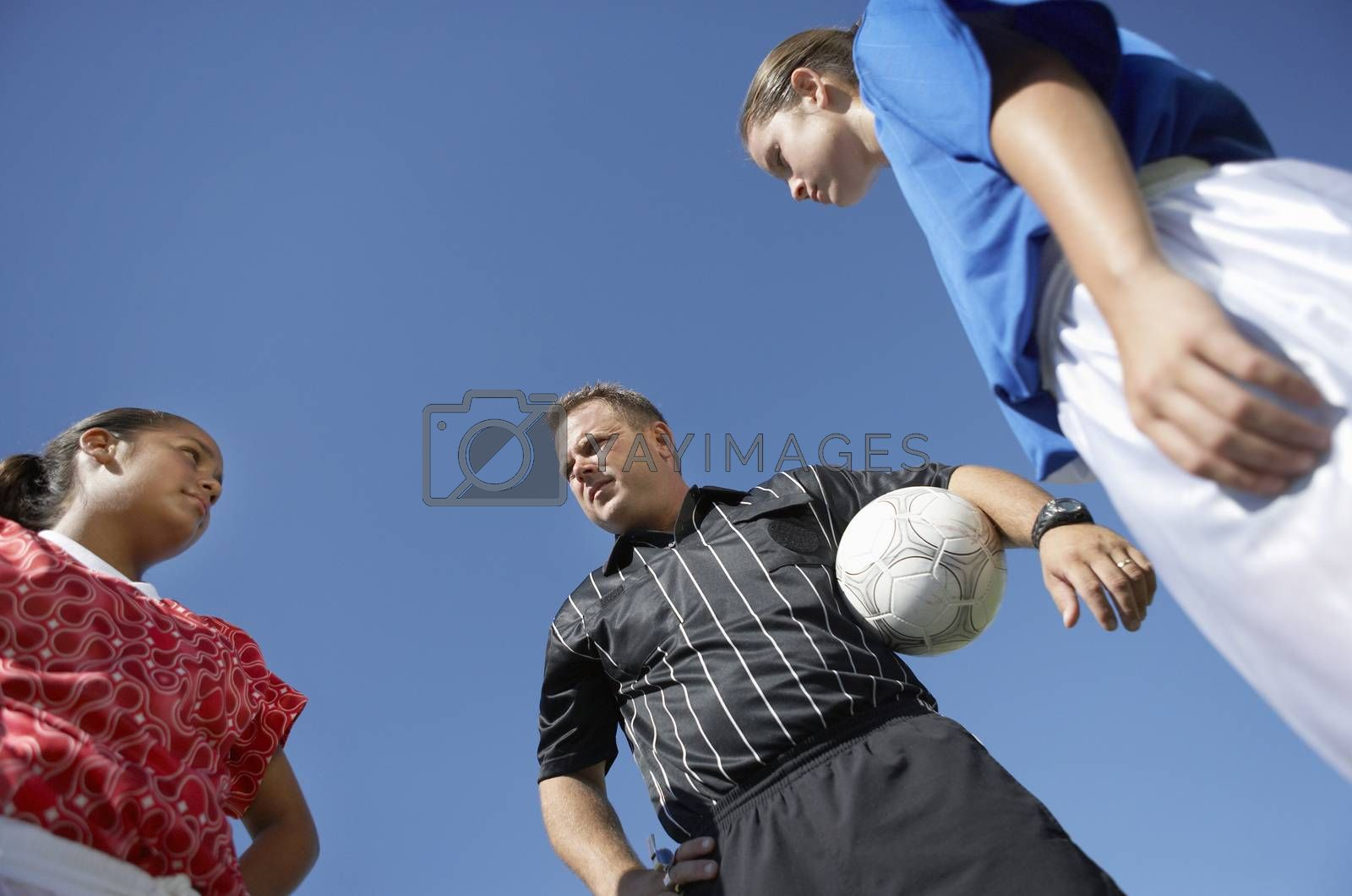 Rival Female Players In Front Of Soccer Referee