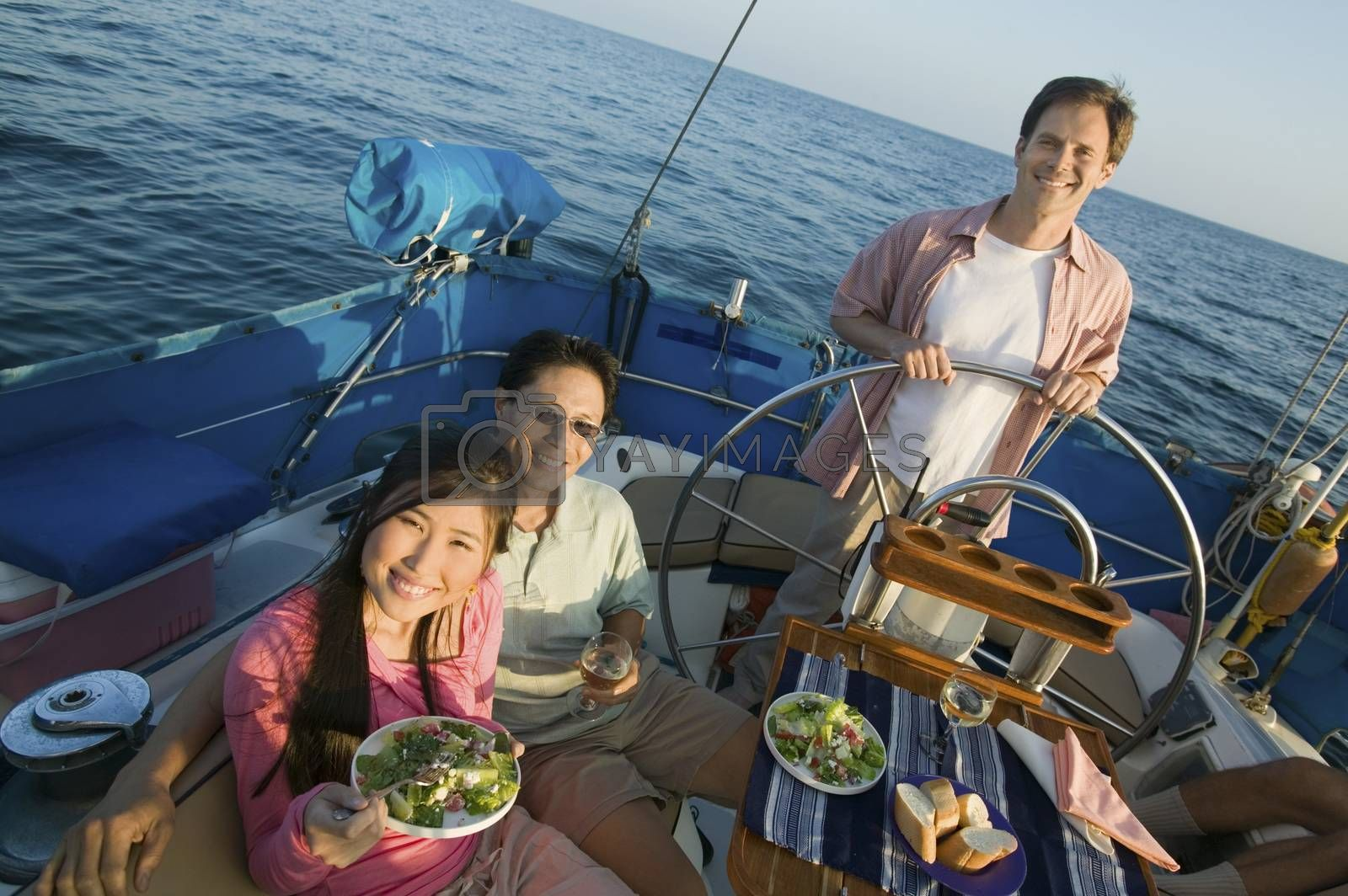 Couple With Male Friend On The Yacht