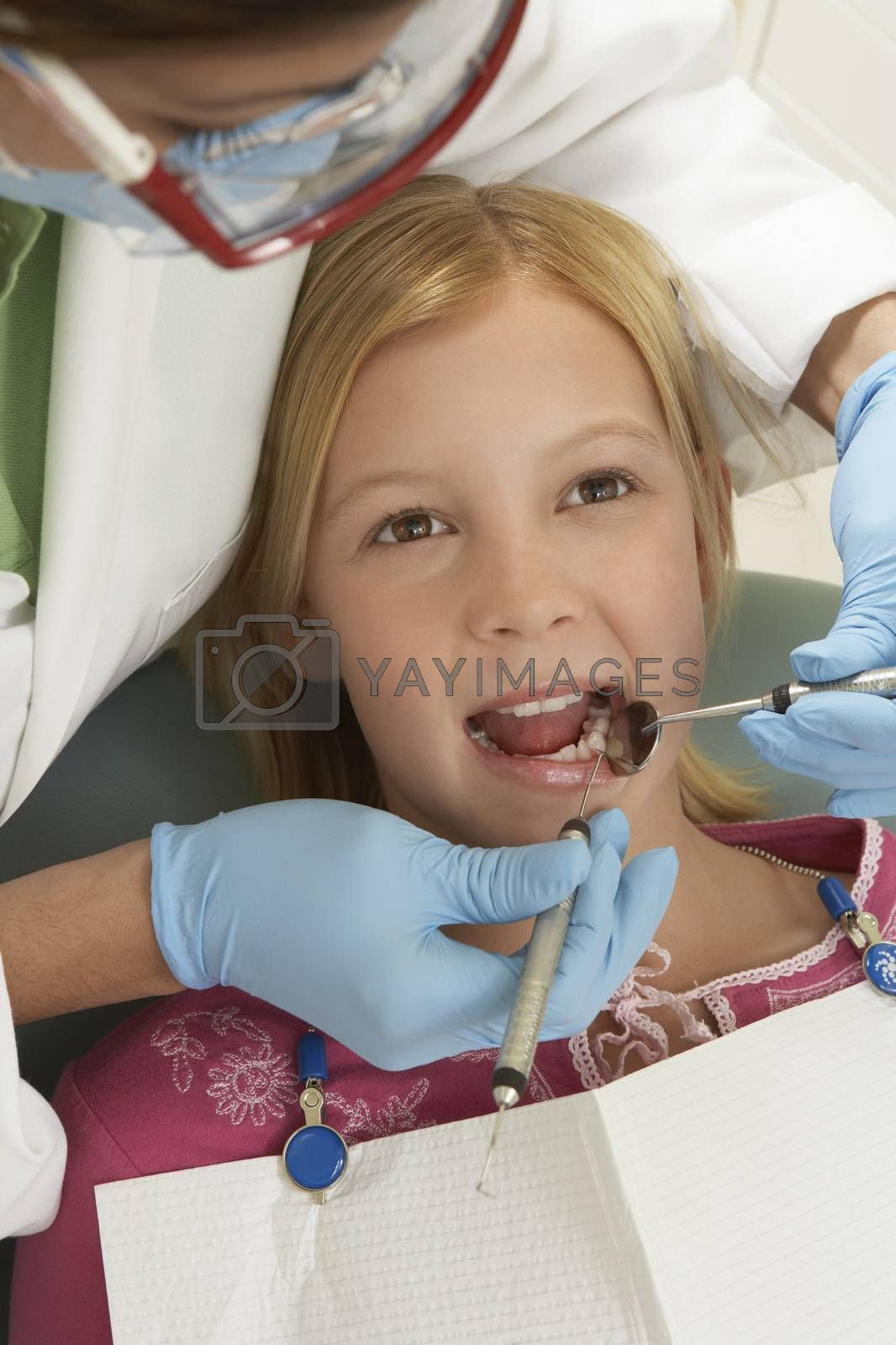 Teenage Girl Being Treated By Dentist