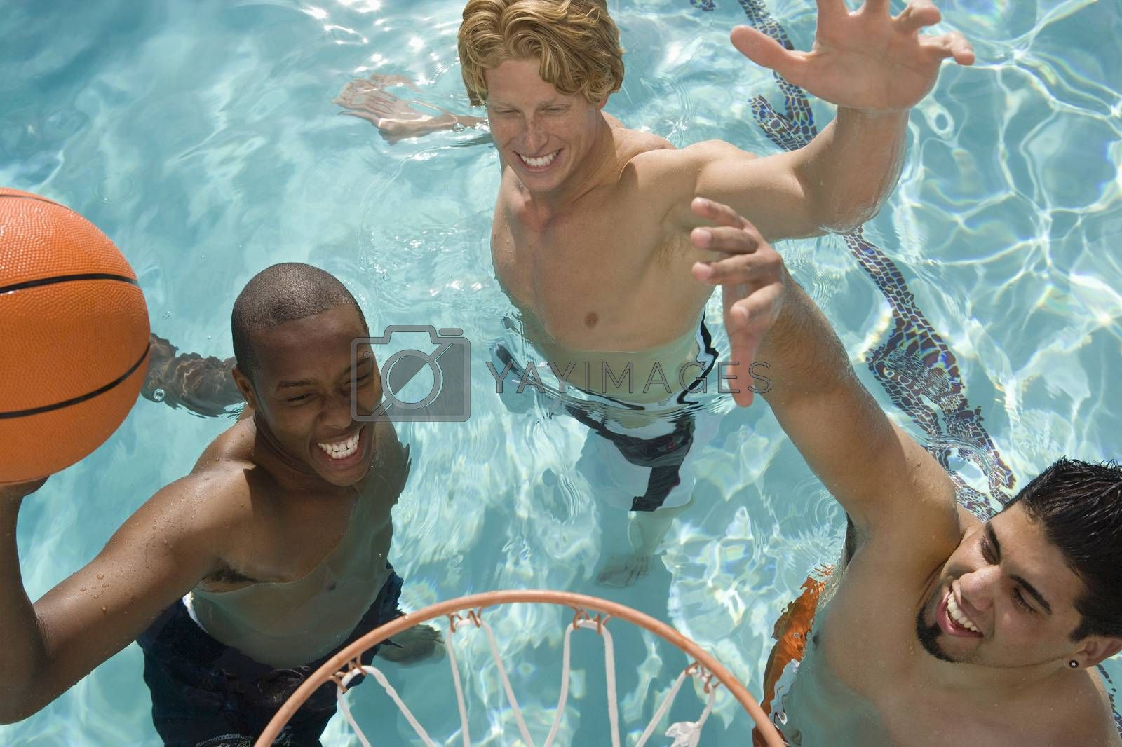 Male Friends Playing Basketball In Pool