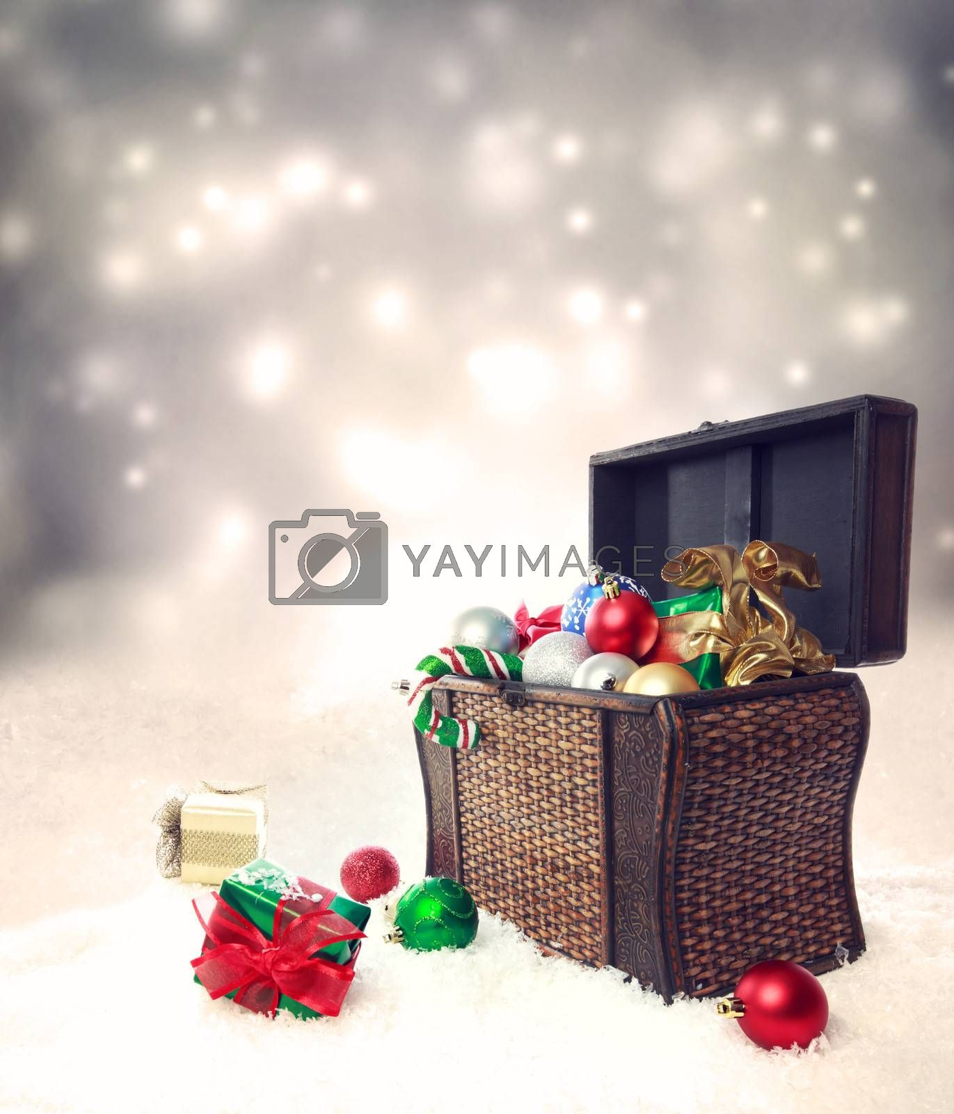 Royalty free image of Treasure box filled with Christmas ornaments and presents by melpomene