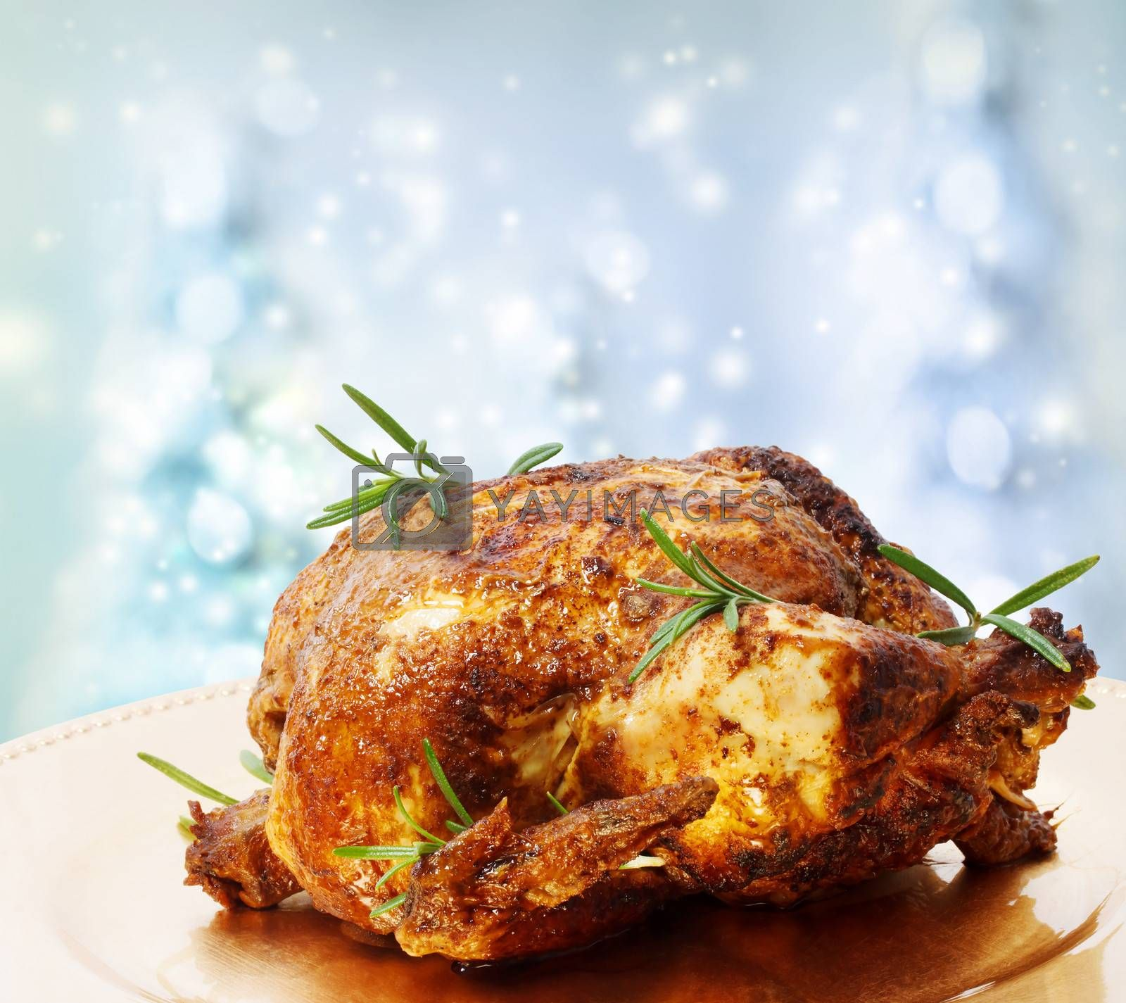 Royalty free image of Roasted Whole Chicken with Rosemary by melpomene