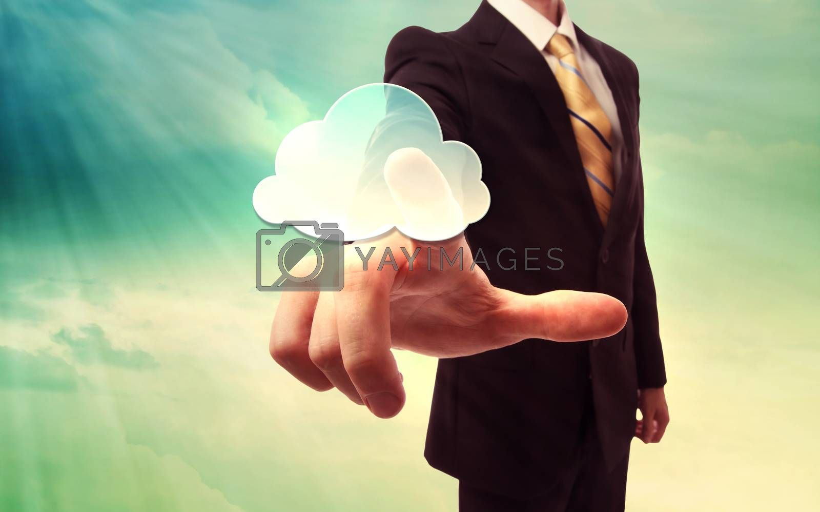 Royalty free image of Businessman pressing a cloud computing icon by melpomene