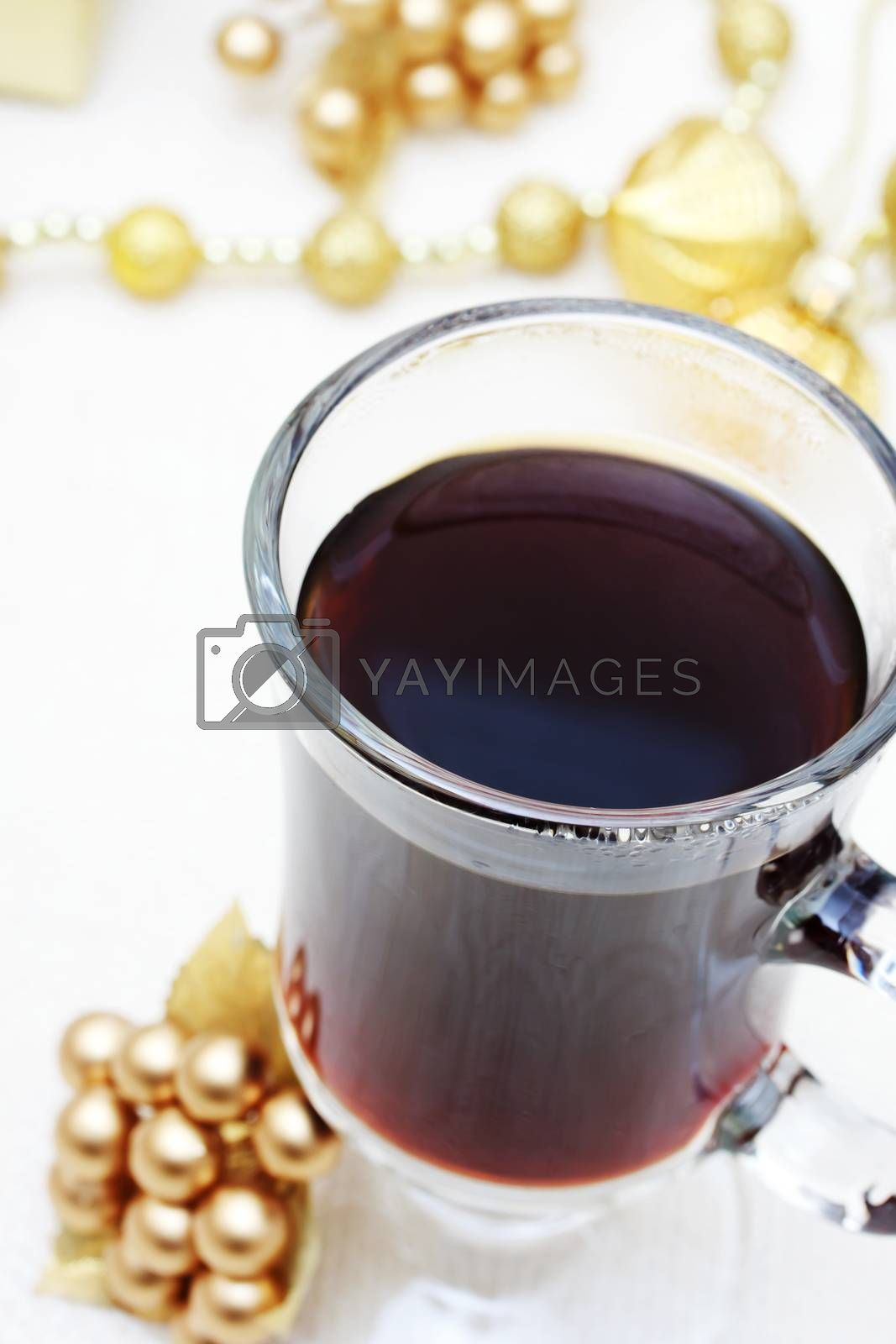 Royalty free image of Cup of Coffee with Christmas Ornaments by melpomene