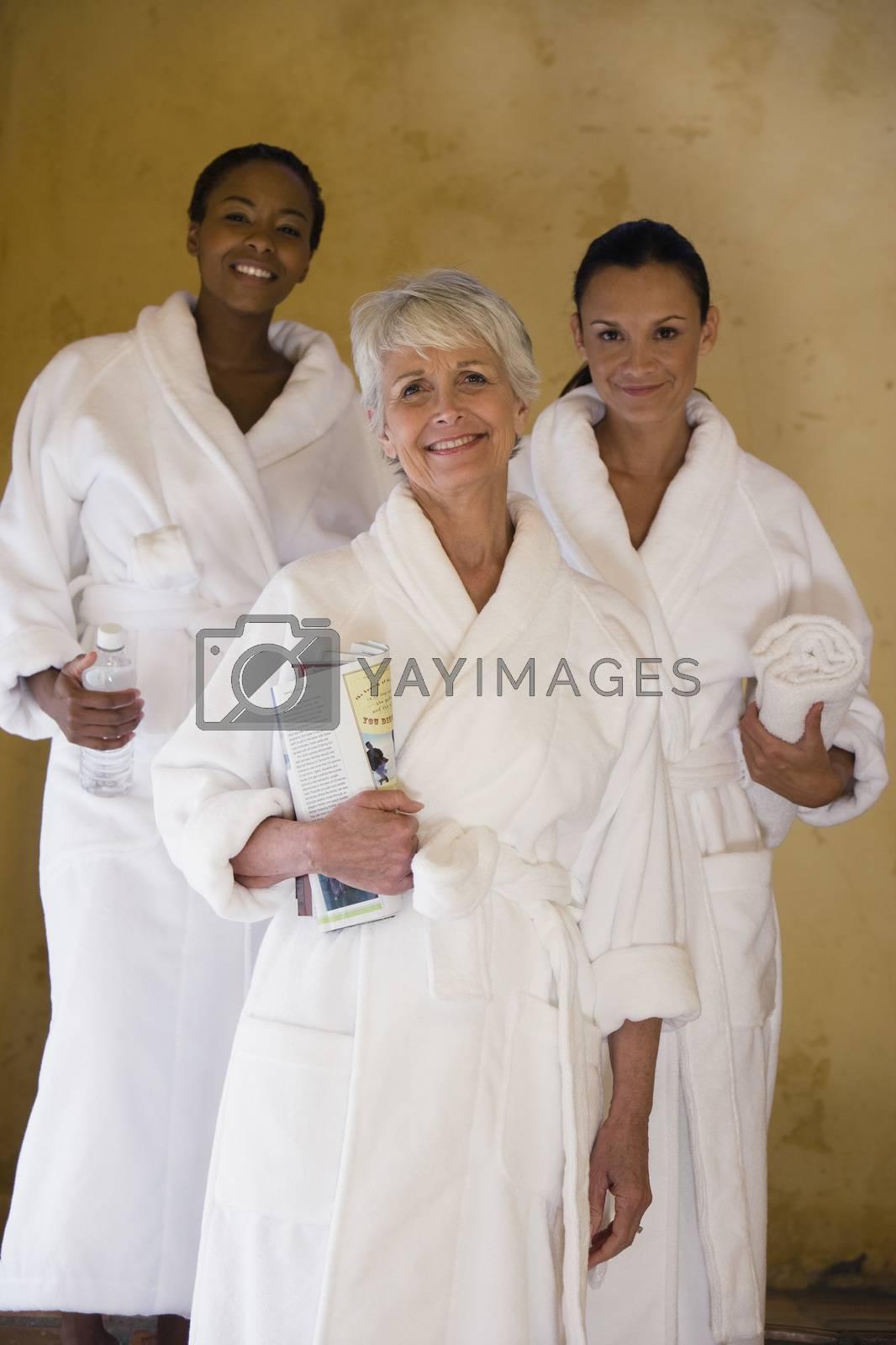 Female Friends In Bathrobe Smiling