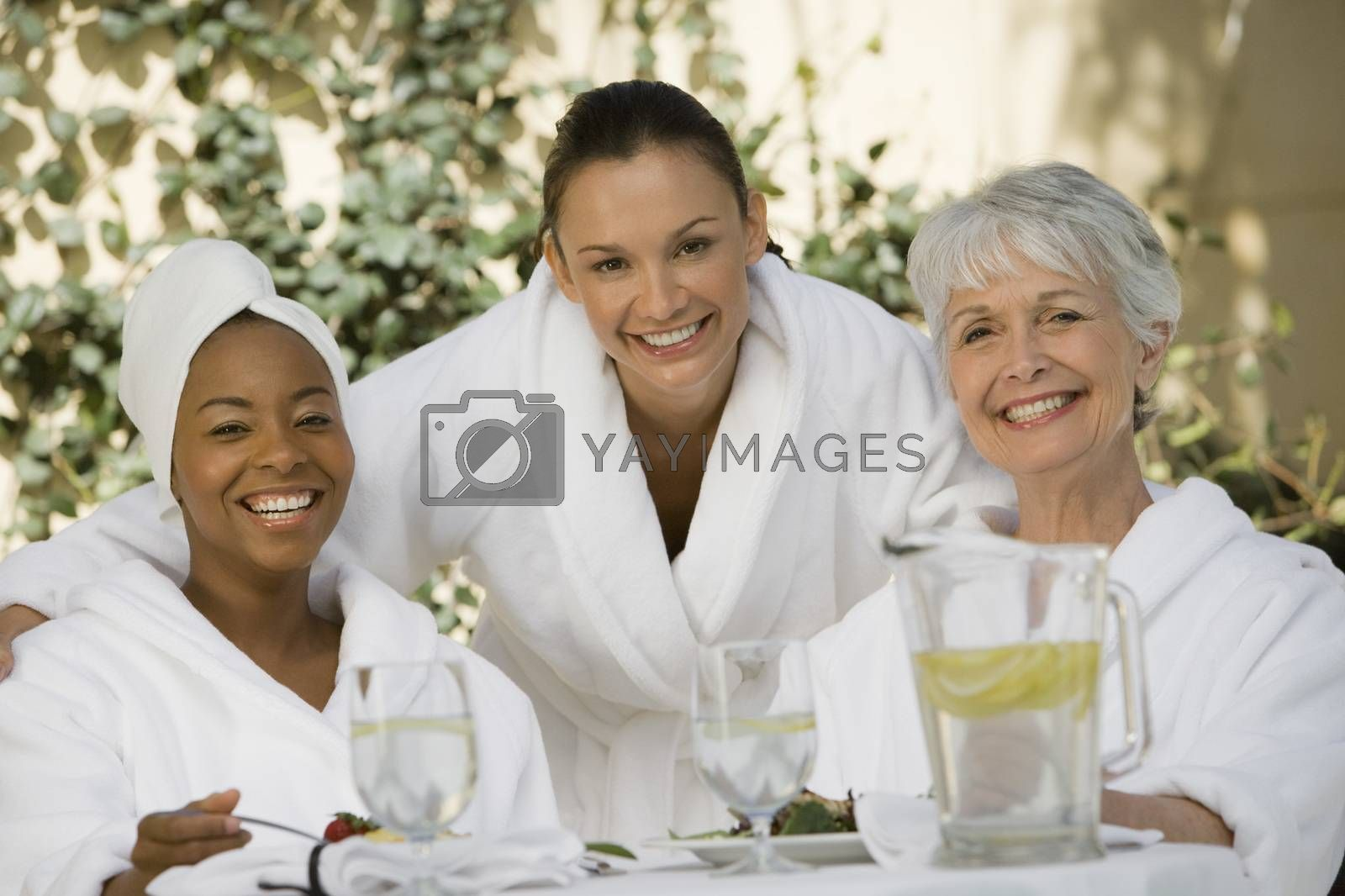 Female Friends At Dining Table