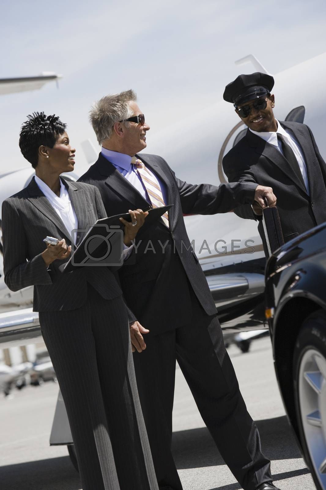 Businessman Taking Briefcase From Driver At Airfield