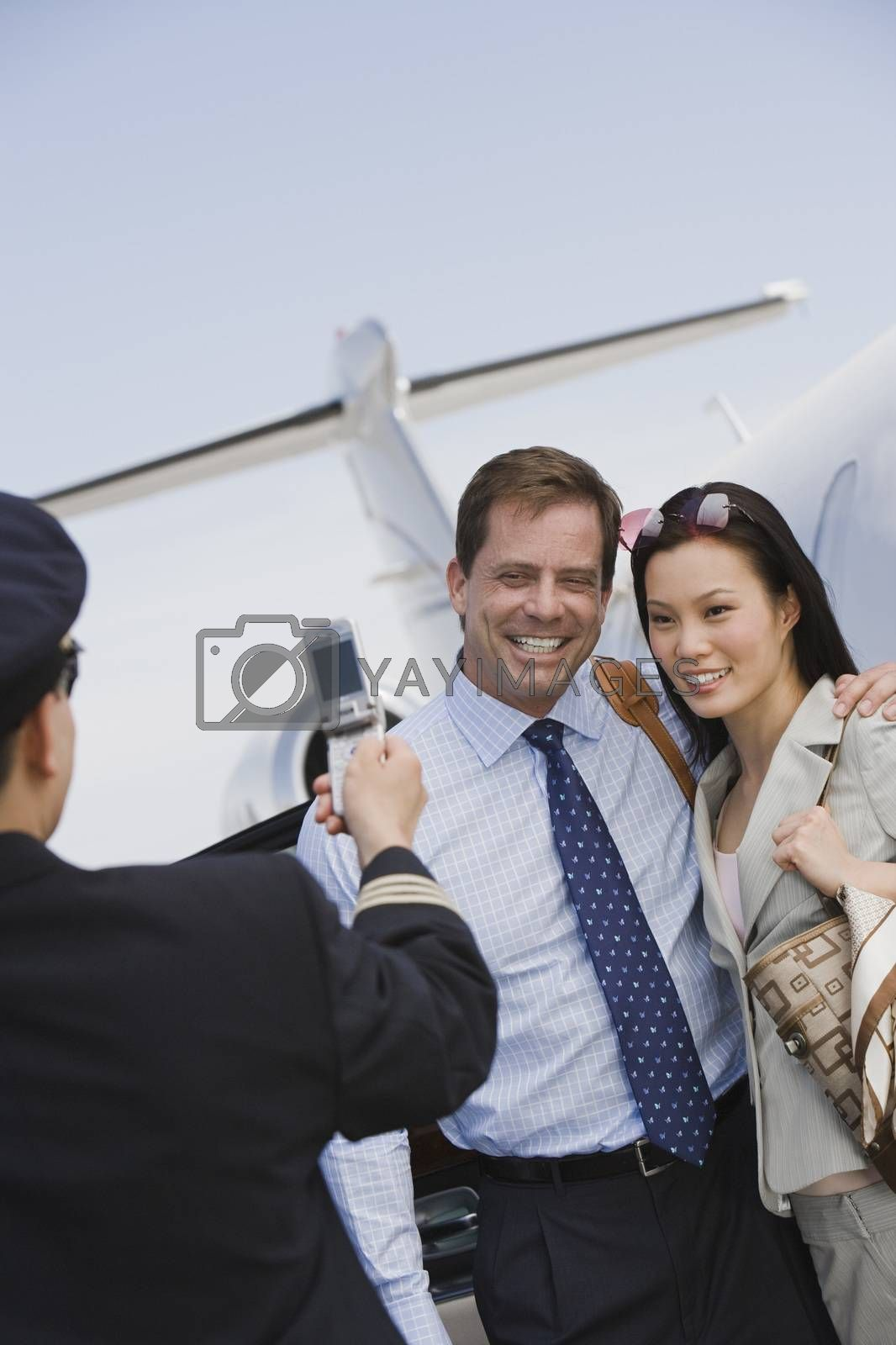 Business Couple Giving Pose For A Photo Click At Airfield
