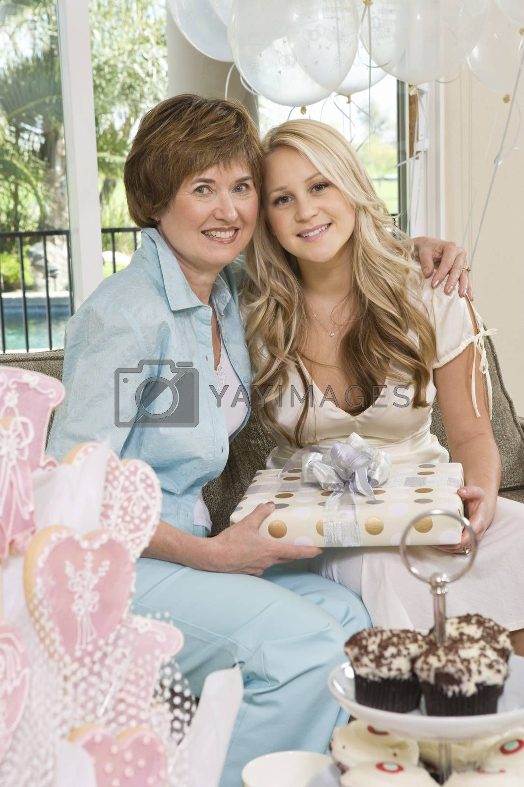 Mother And Daughter Holding Gift