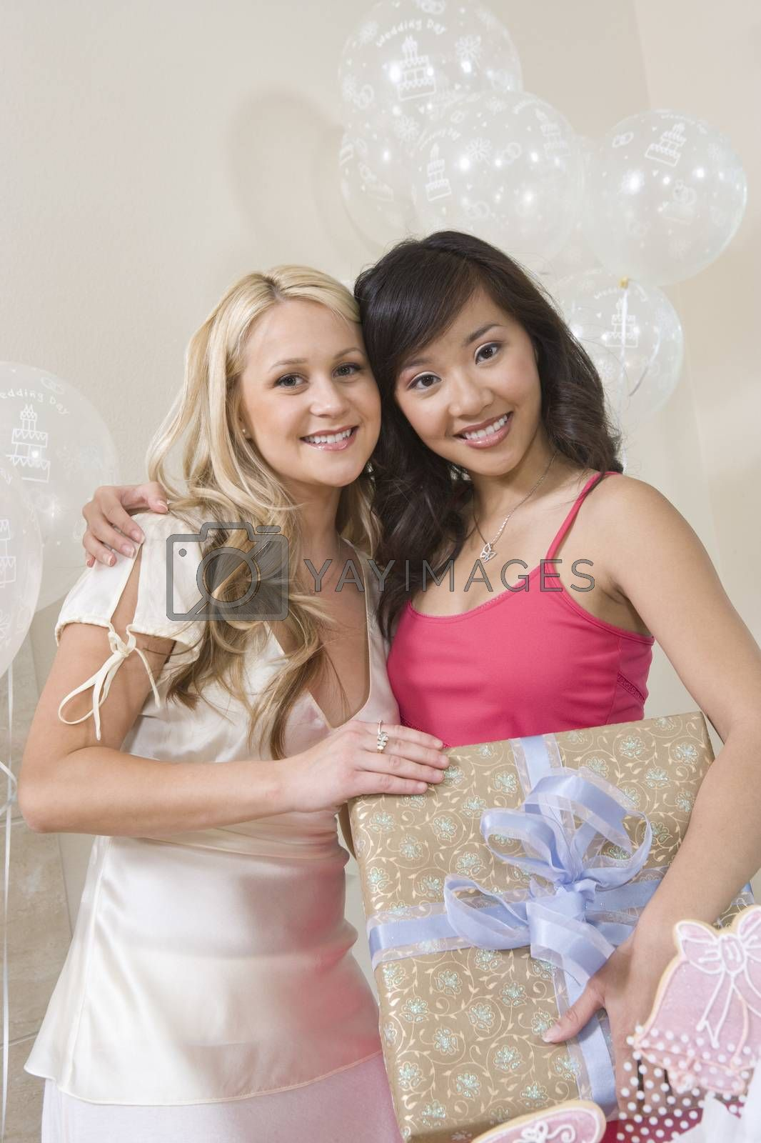 Portrait Of Bride And Friend Holding Gift
