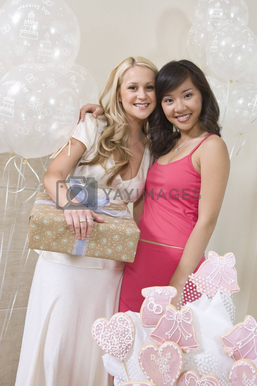 Bride Holding Gift While Standing With Friend