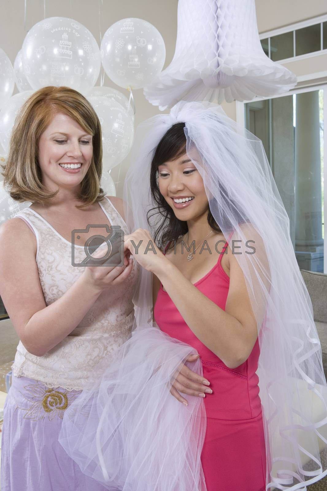 Bride With Her Friend Looking At Engagement Ring