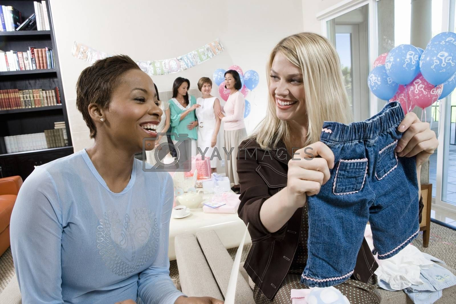 Women at a Baby Shower with baby Clothes