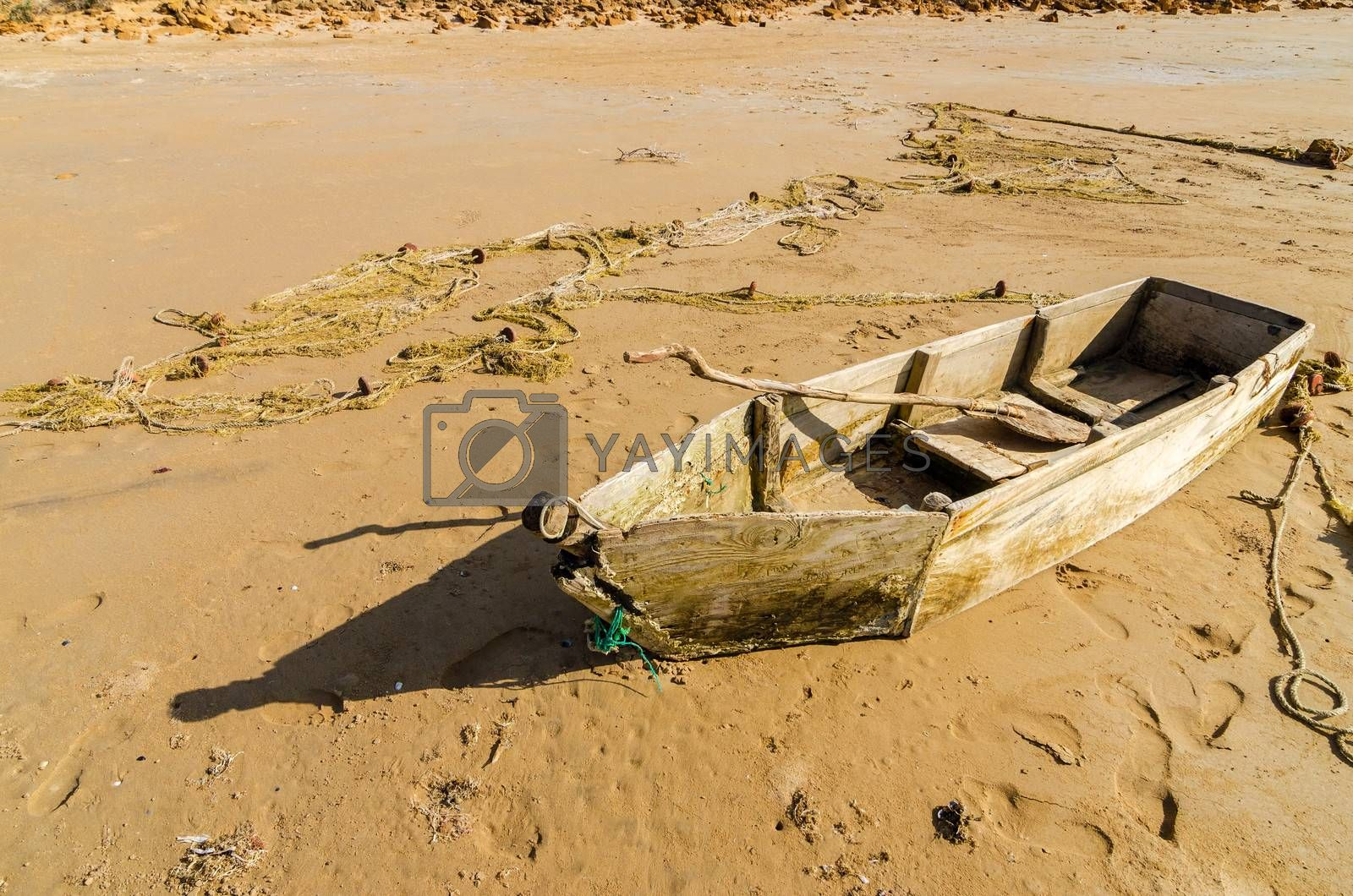 Old dilapidated canoe on a beach in La Guajira, Colombia