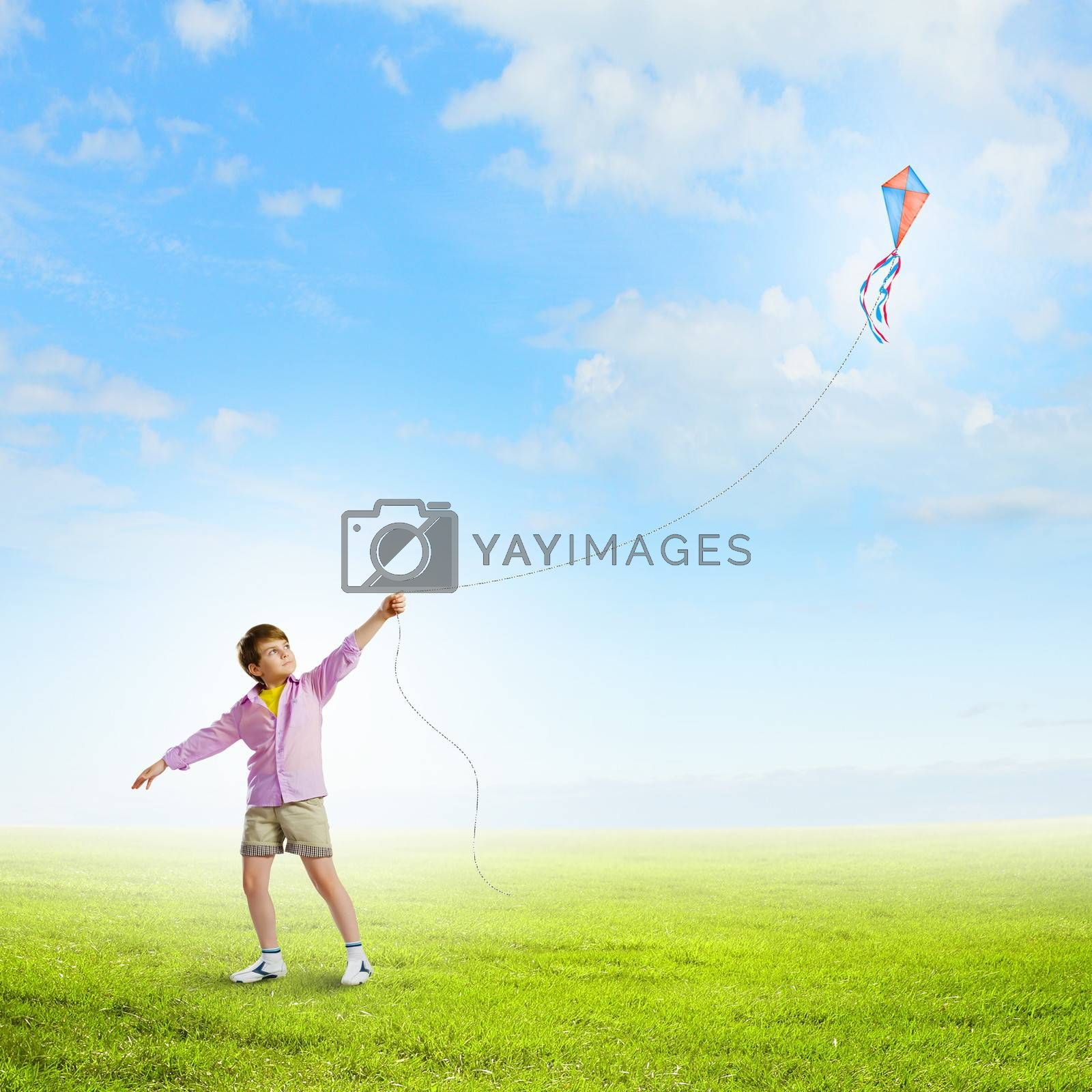 Royalty free image of Boy with kite by sergey_nivens