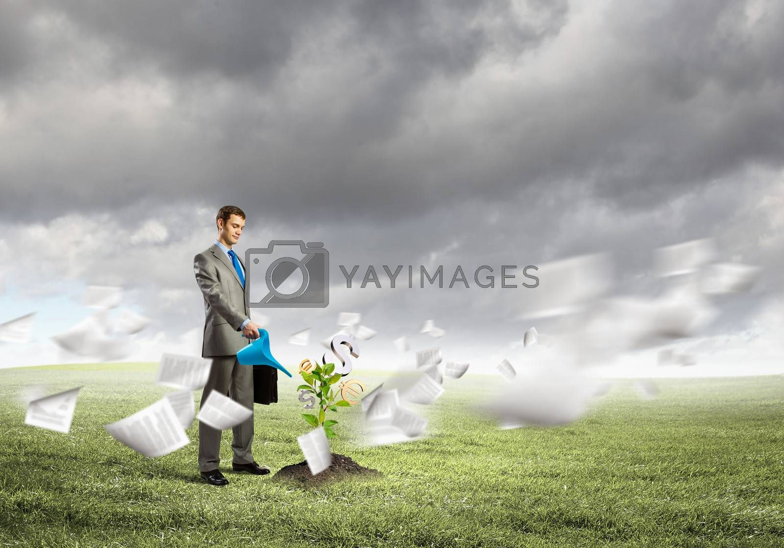 Image of young businessman watering money tree with euro symbols