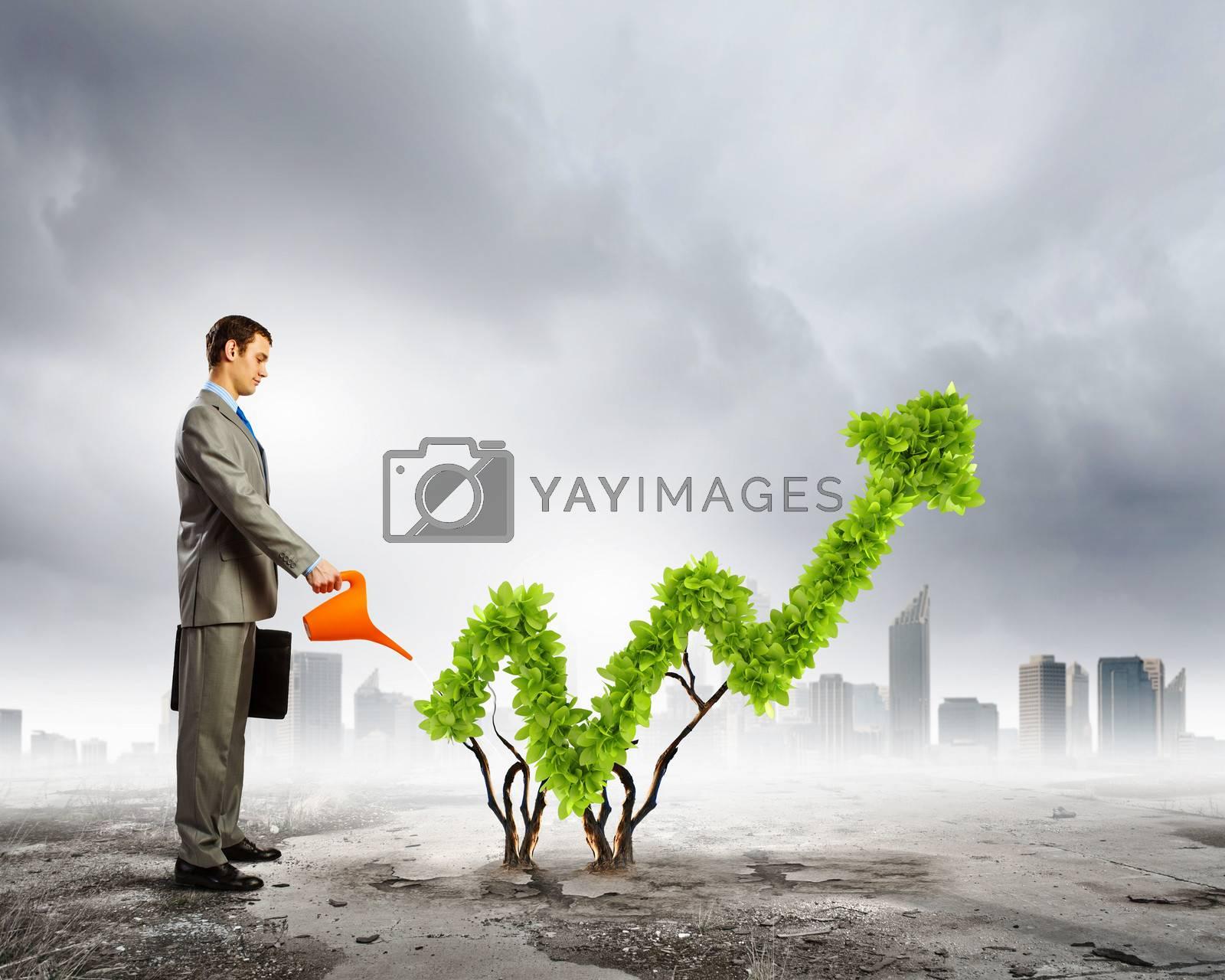 Image of businessman watering plant shaped like arrow