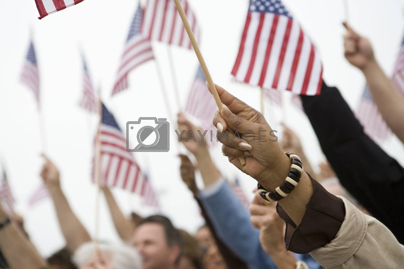 Hands Raising American Flag