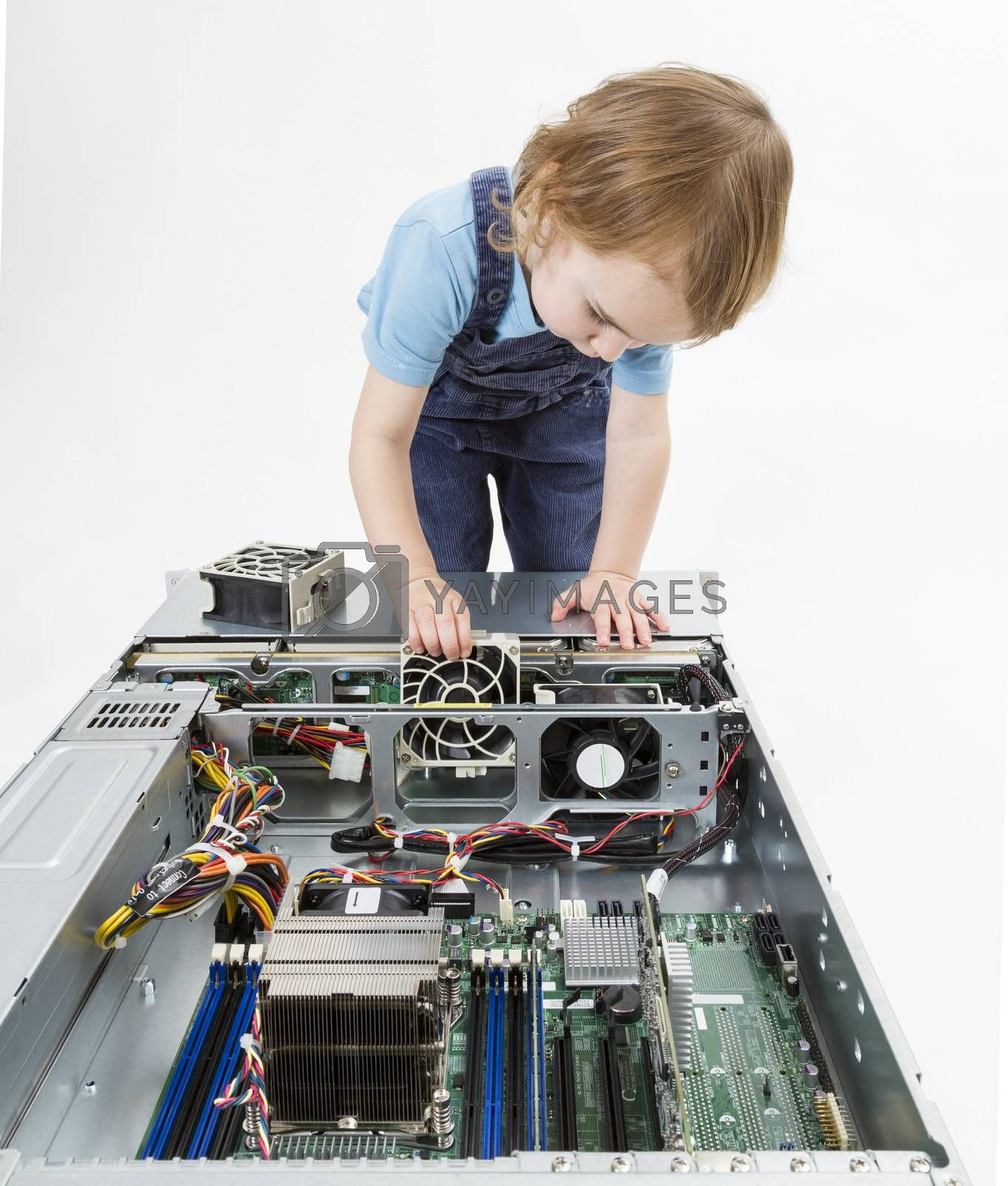 young child working on network server. studio shot in grey background