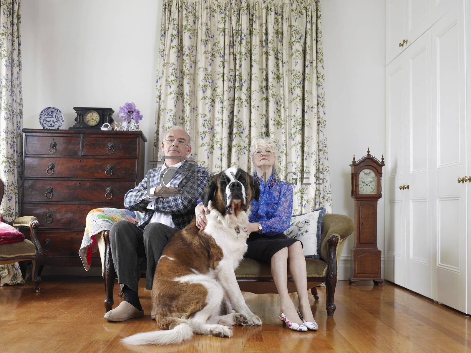 Senior Couple Sitting With Their Pet Dog