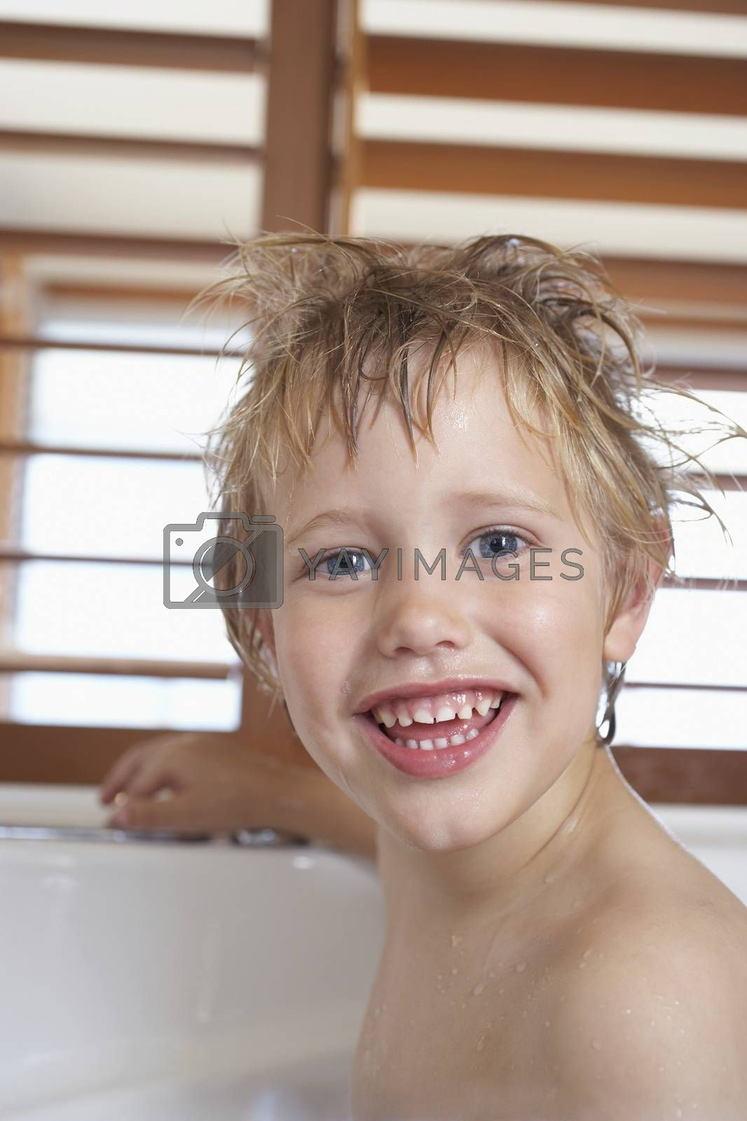 Royalty free image of Boy with messy wet hair in Bathtub close-up by moodboard