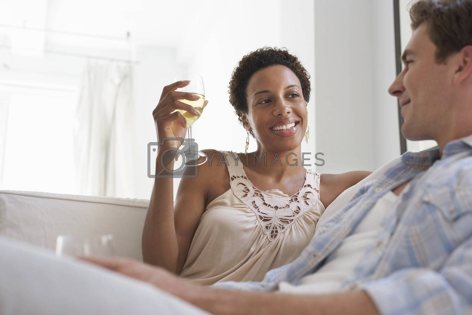 Couple With Wine Glasses In Living Room