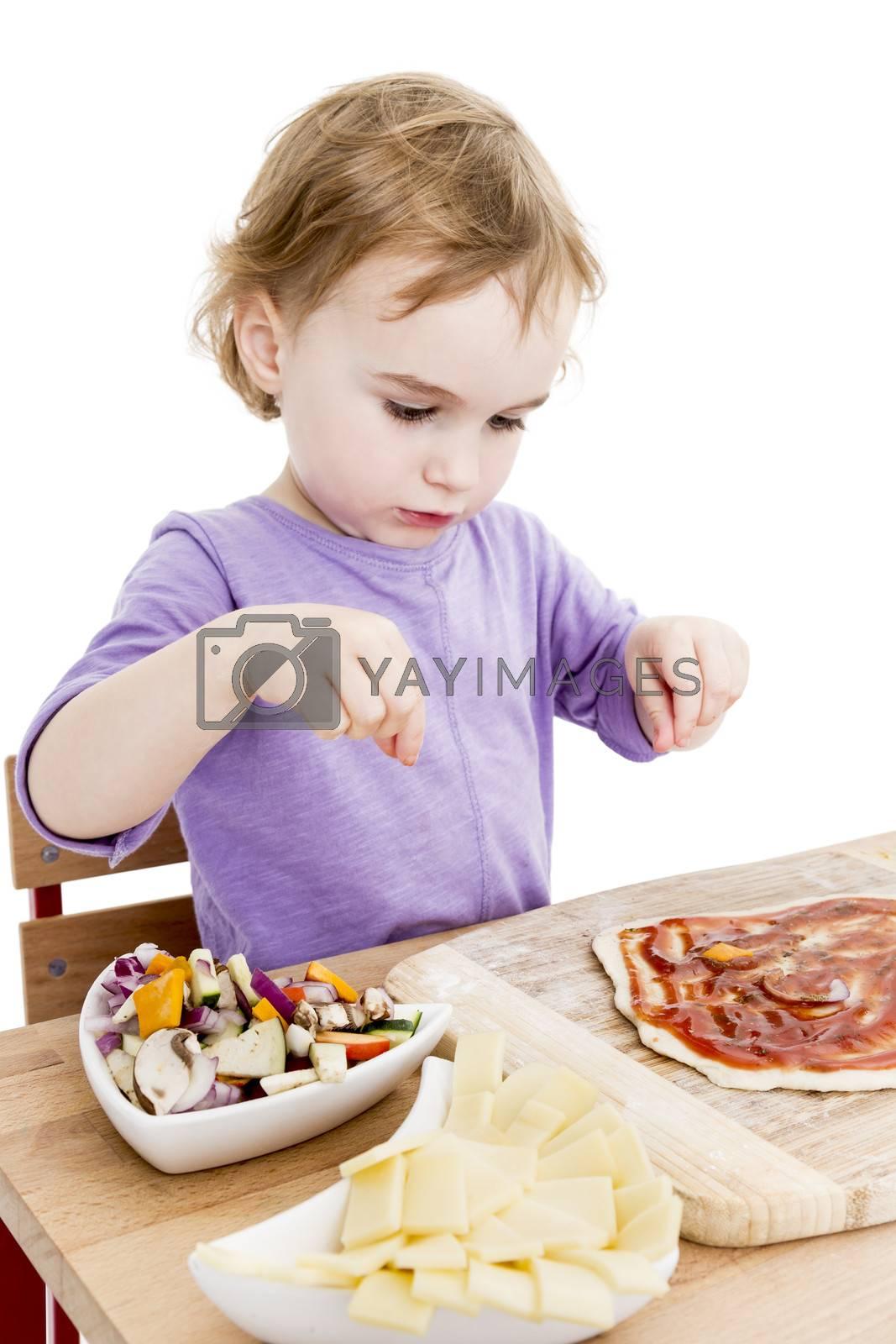 girl making fresh pizza in white background. studio shot