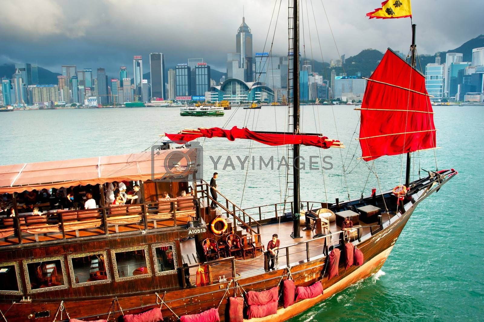 Hong Kong - May18, 2013: Traditional chinese-style tourist junk sailing in Hong Kong harbor . Overall visitor arrivals to Hong Kong in 2012 totalled just over 38 million, a 24% increase over the previous year.