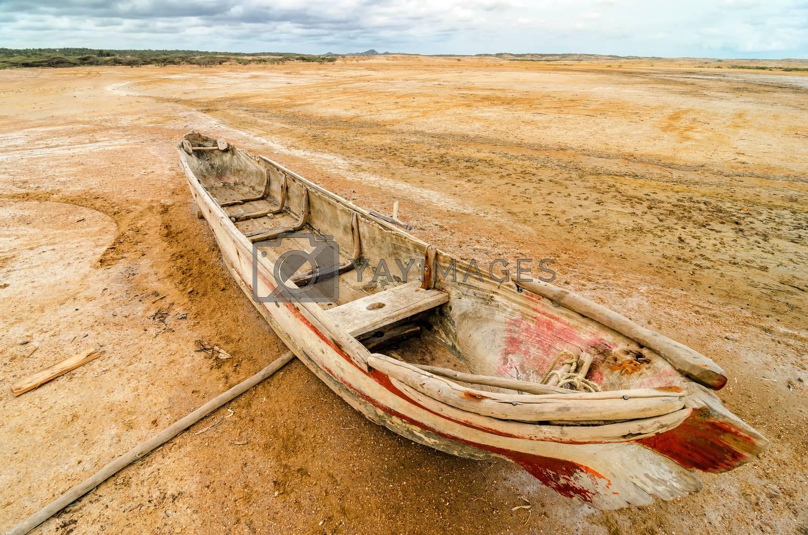 Old dugout canoe stranded in a desert