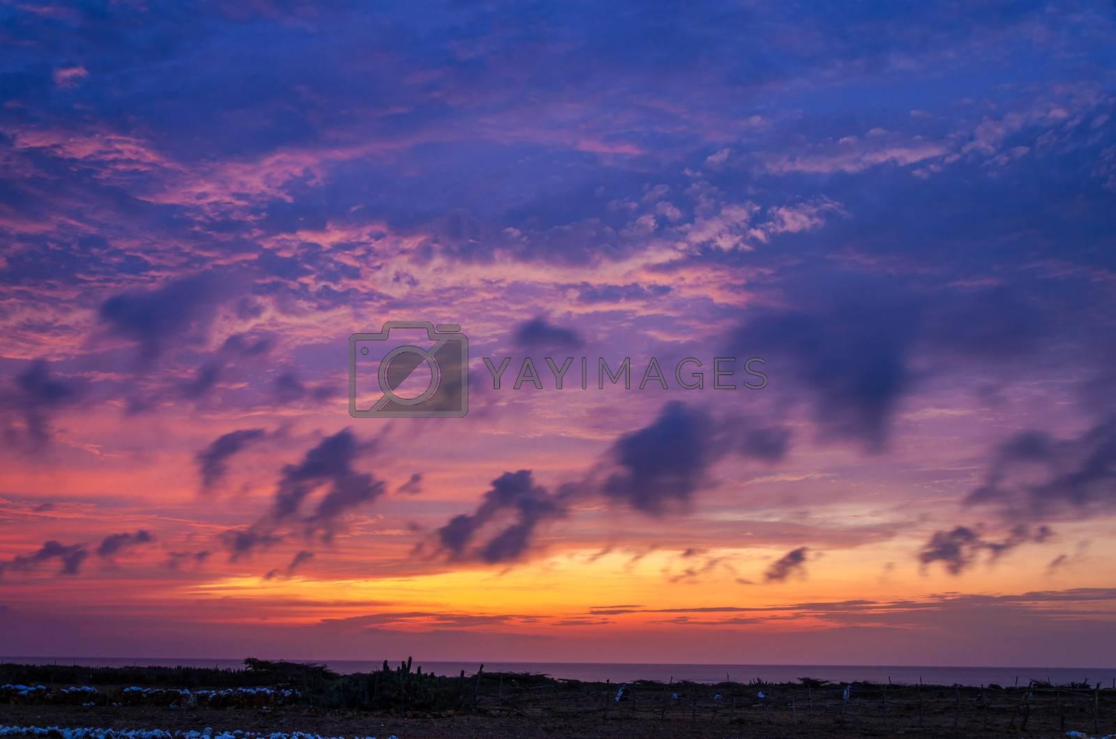 Purple, yellow, and orange sunset in La Guajira, Colombia
