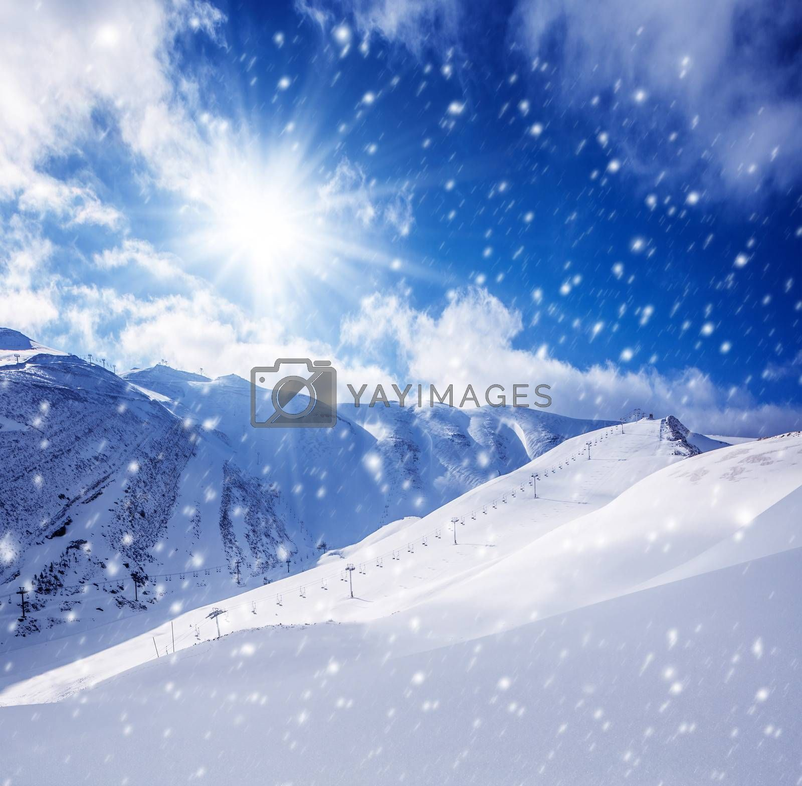 Beautiful winter landscape, high mountains covered with white snow, frosty sunny day, snowy weather, luxury ski resort