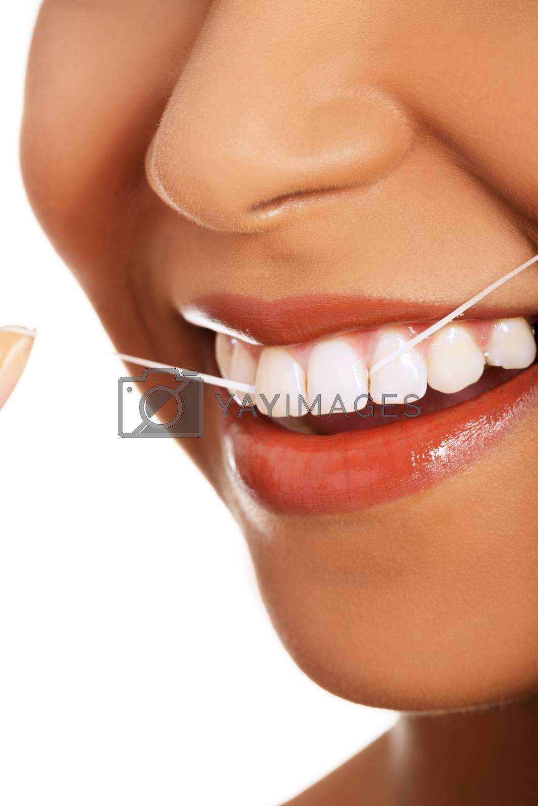 Attractive woman with dental floss. Closeup.  Mouth and teeth. Isolated on white.