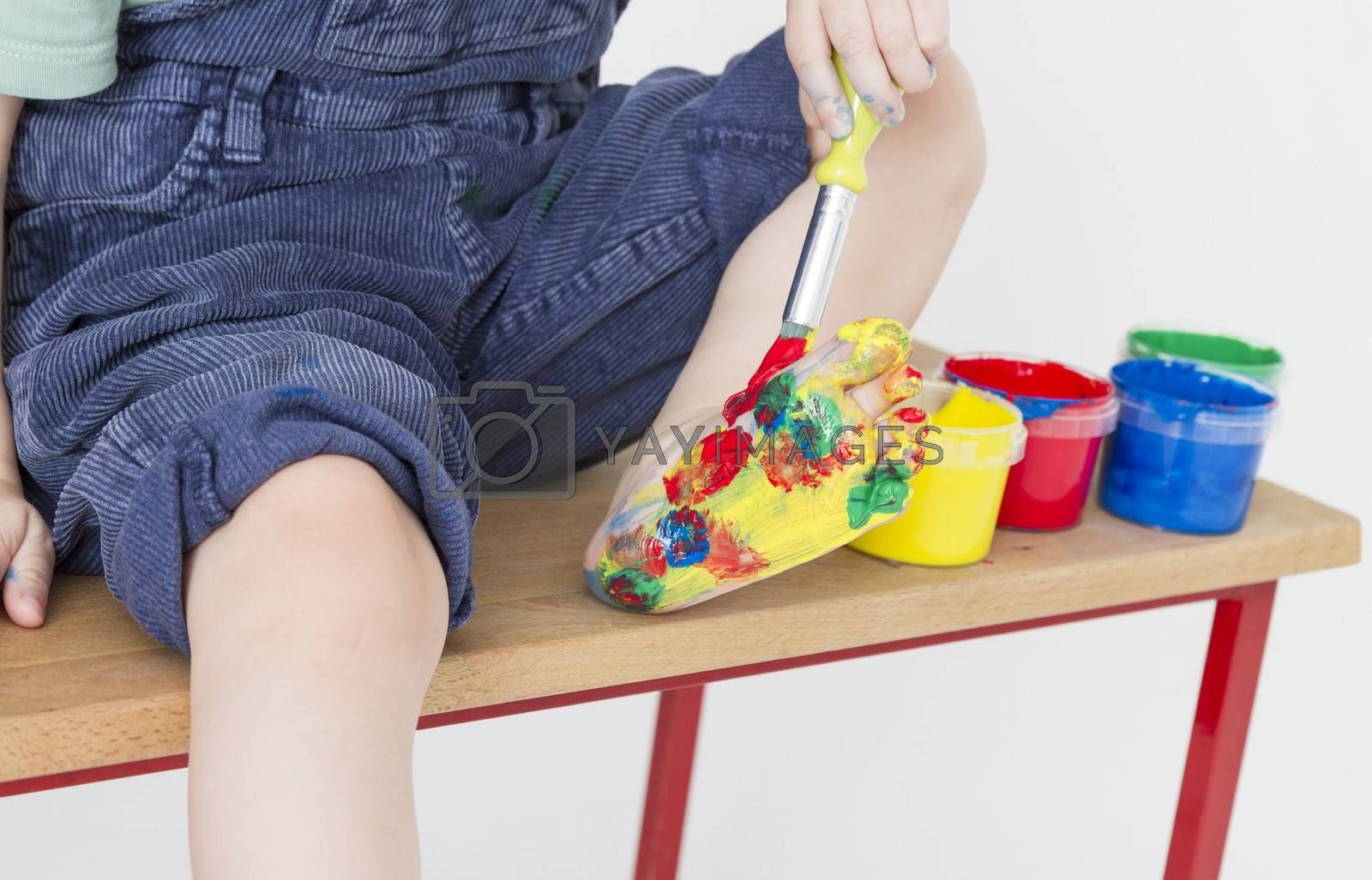Royalty free image of foot of child colorful painted by gewoldi