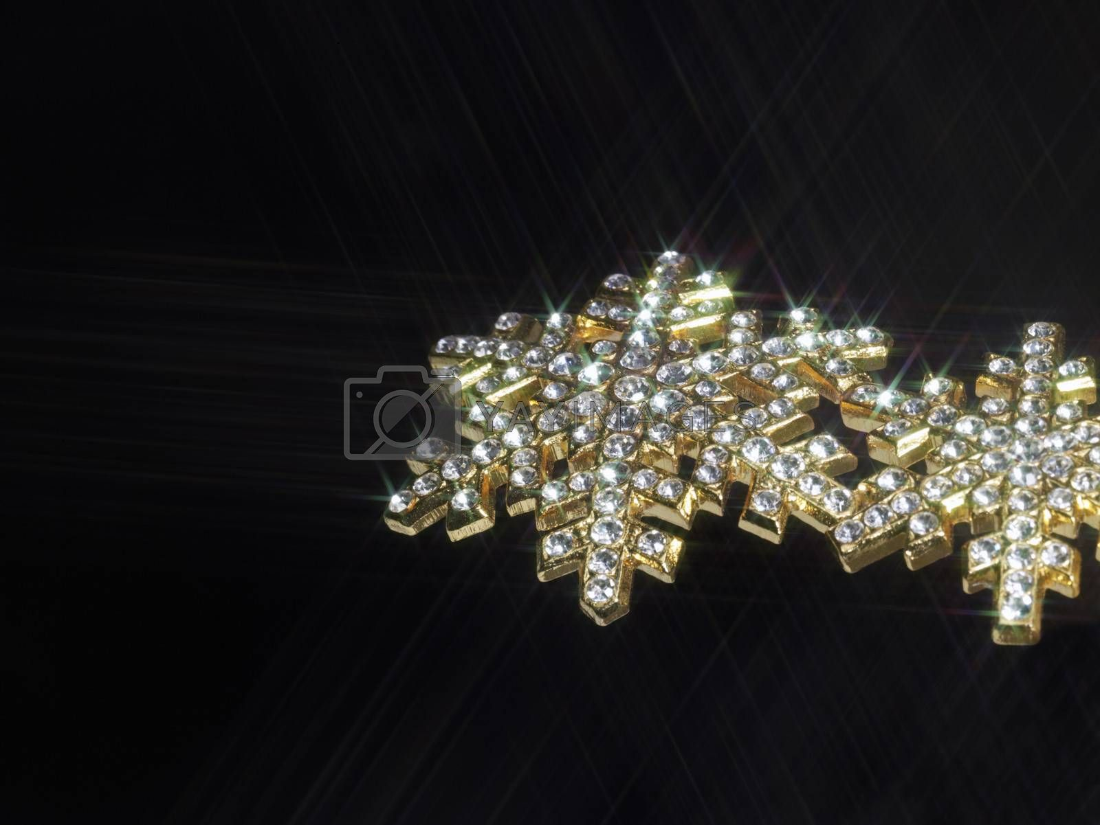 shiny jewelry in dark back, effective illuminated with a optical star-filter
